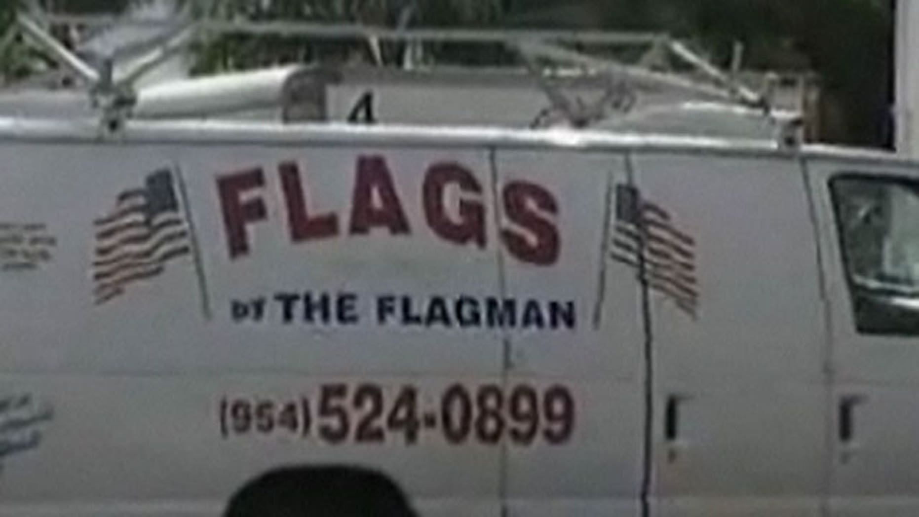 """Andrew Chiotis, also known as """"The Flagman,"""" owns the van. He makes a living selling American flags."""