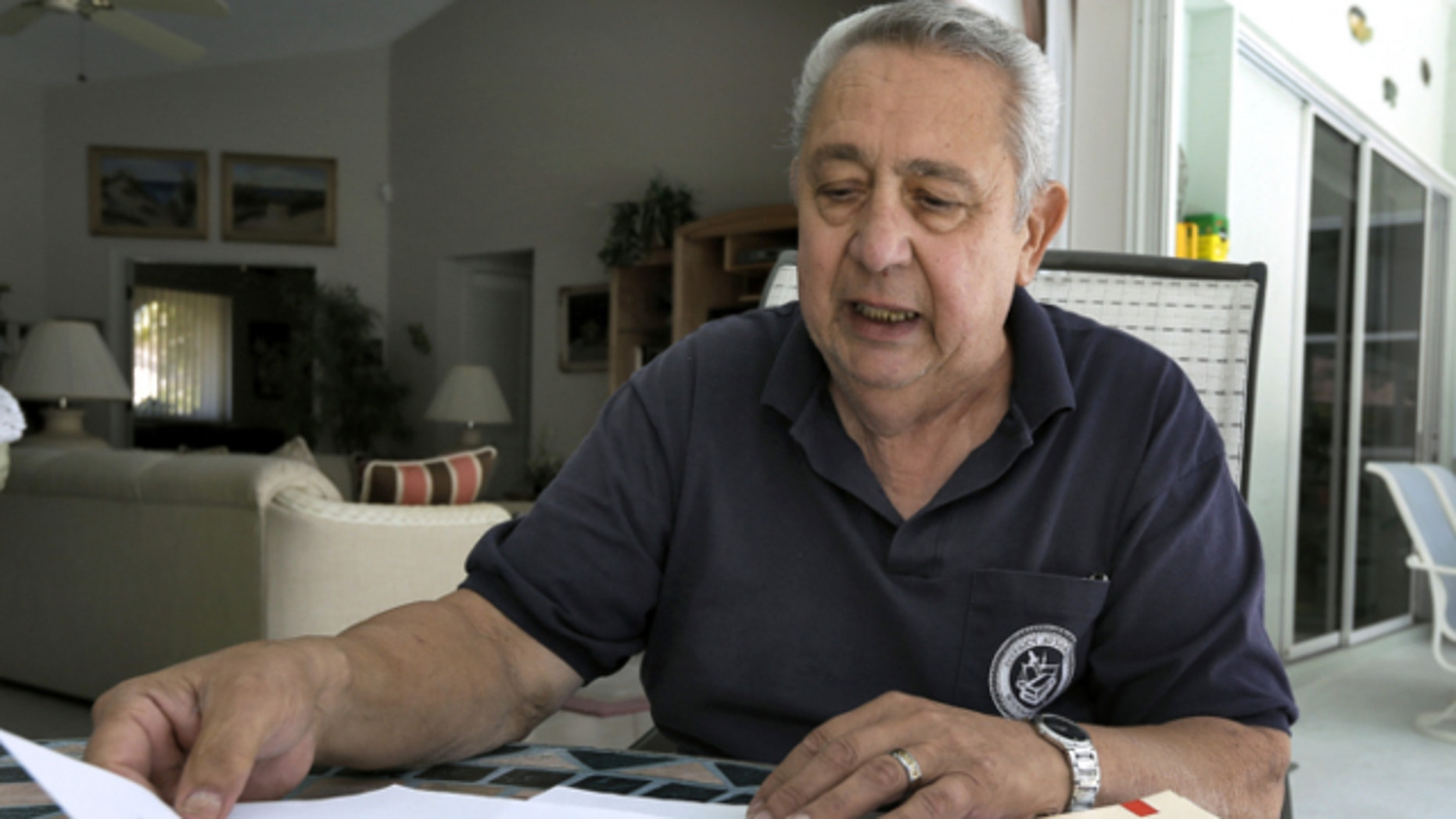 March 21, 2013: Tom Gervasi looks over some his Department of Veterans Affairs rejection letters in Sarasota, Fla.