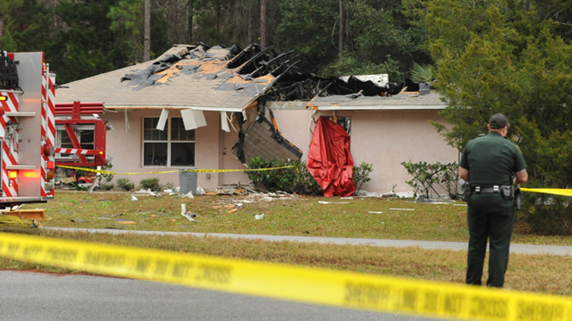 Jan. 4, 2013: Emergency personnel investigate the scene of a plane crash in Palm Coast, Fla.
