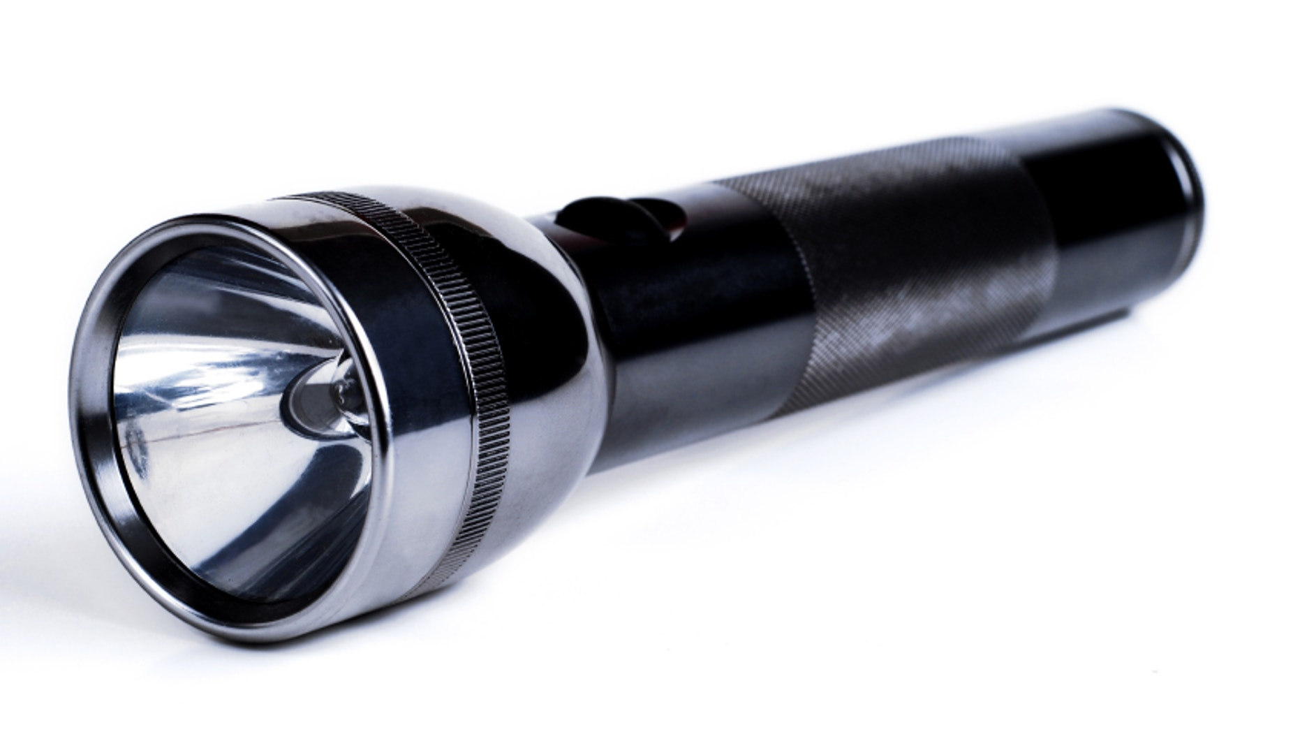 stainless 2 cell flashlight on white