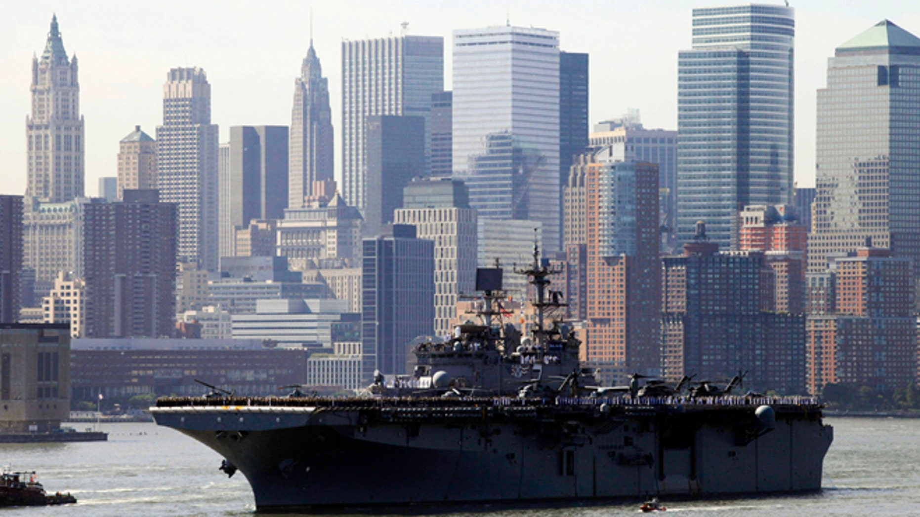 May 26, 2010: Sailors line the deck of the USS Iwo Jima as it passes the lower Manhattan skyline on arrival in New York Harbor for the start of Fleet Week. After a year's absence, Fleet Week is coming back to New York City. Three Navy ships and two Coast Guard cutters are scheduled to arrive in New York Harbor on Wednesday, May 21, 2014, the start of the week. (AP/Mark Lennihan, File)