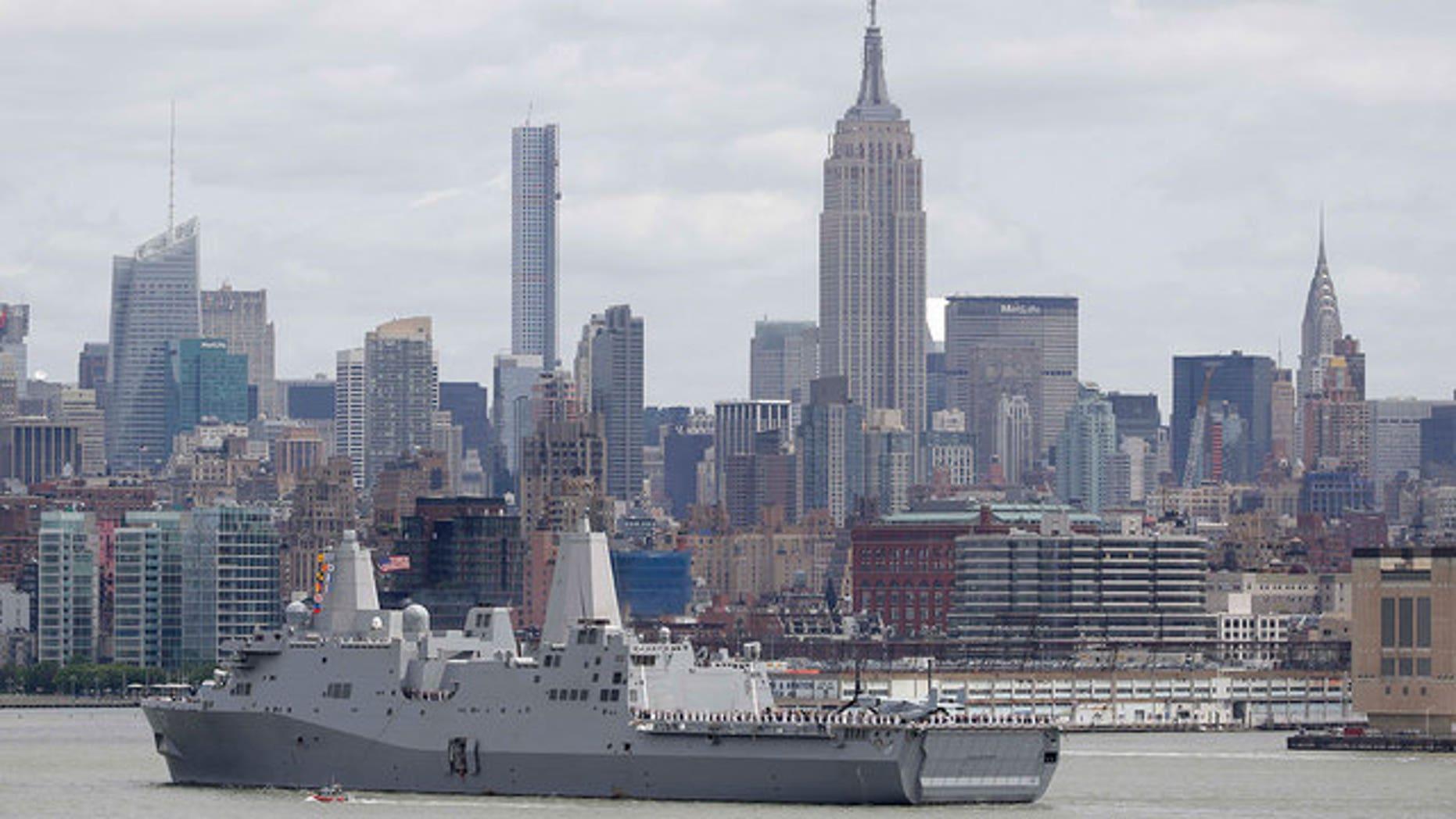 A U.S. Navy ship arrives in New York Harbor to mark the start of Fleet Week.