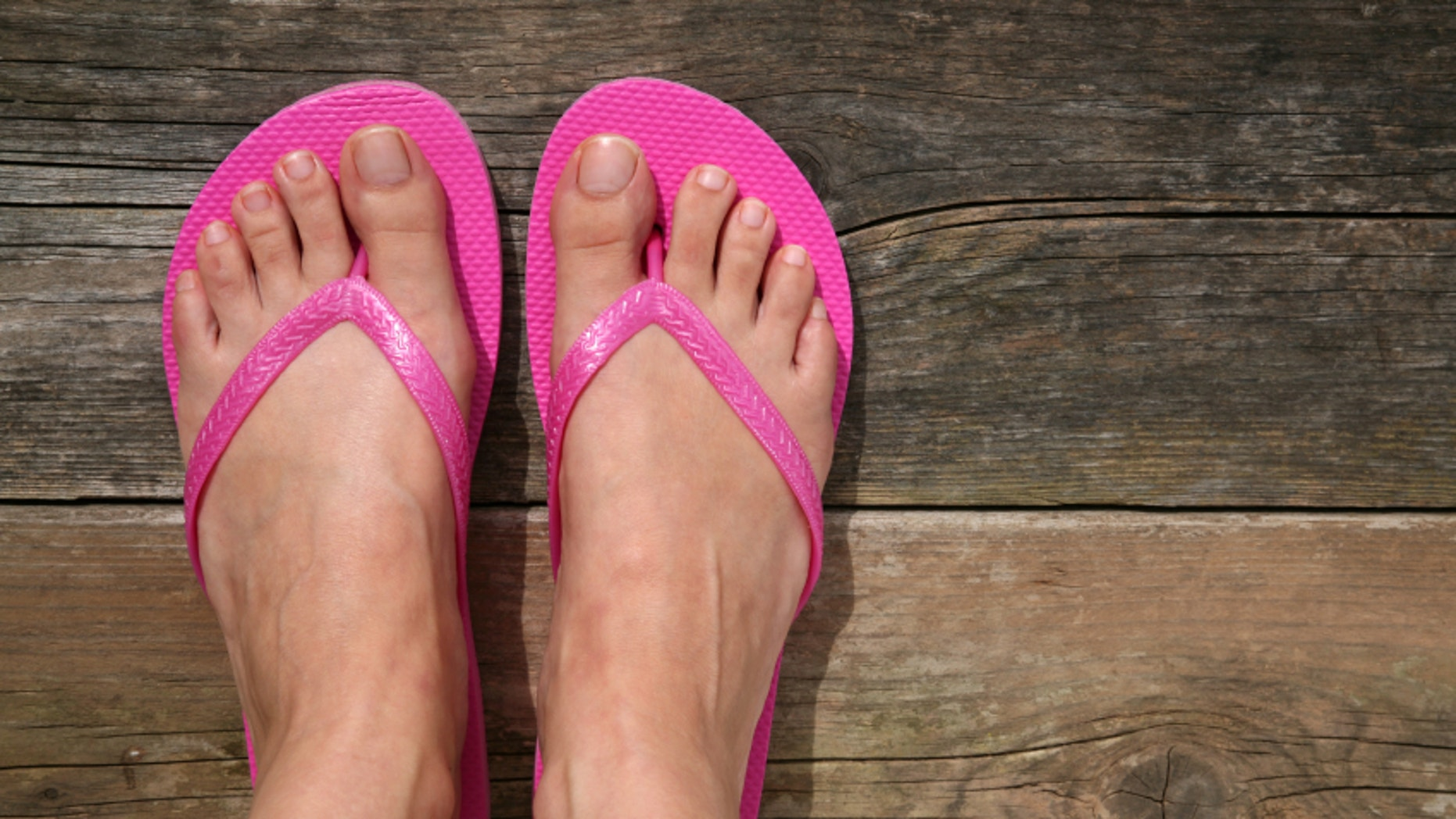 The proposed code, which bans exercise clothing and flip-flops, also mandates that hair and nails be clean and neatly groomed. And while blue jeans are explicitly prohibited, district employees can wear 'dress jeans' with no visible tears or fraying.