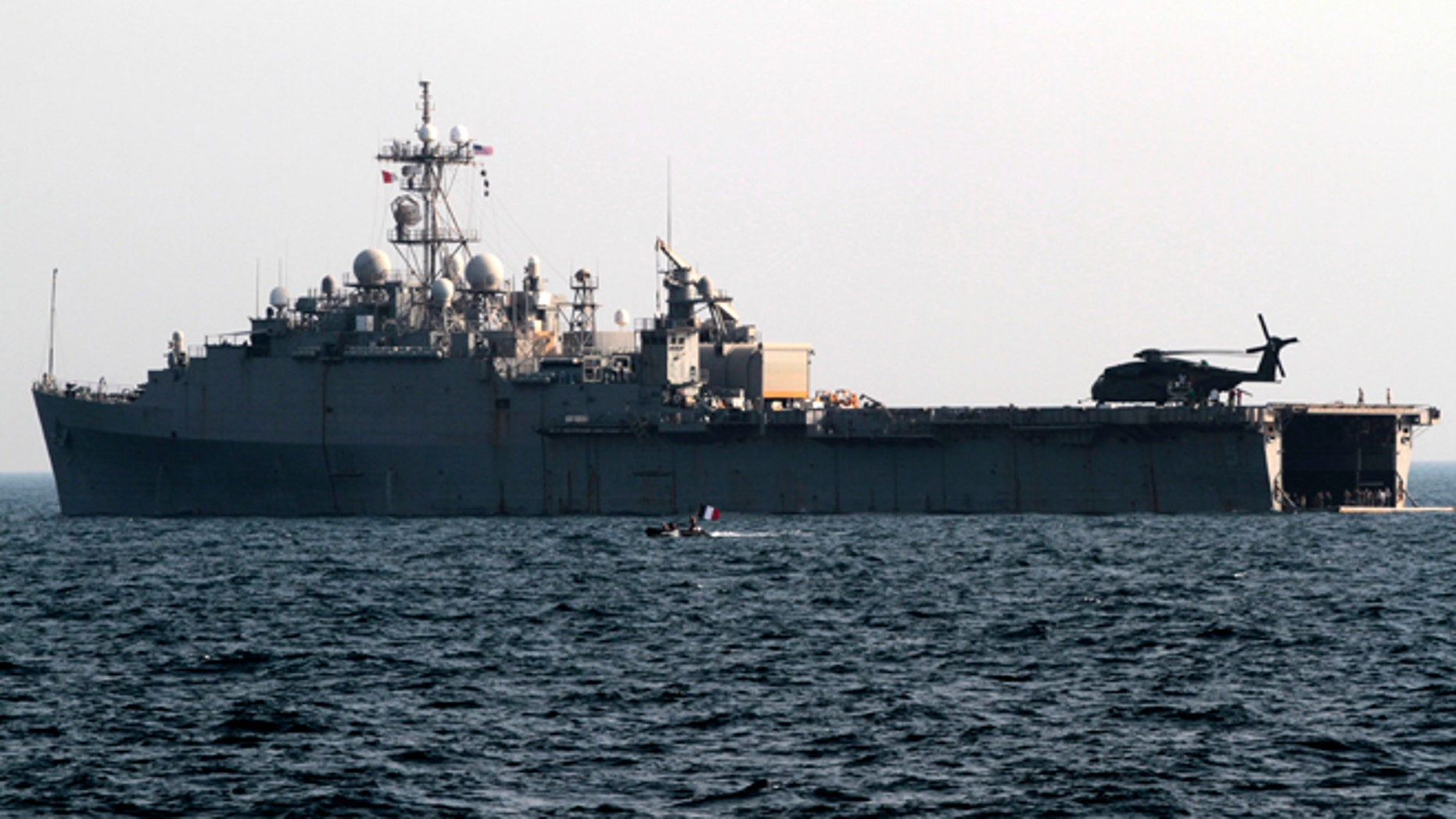 Sept. 21, 2012: A French speedboat deployed from the back of the USS Ponce in the Persian Gulf passes by the U.S. Navy's floating base used to support mine countermeasure operations.