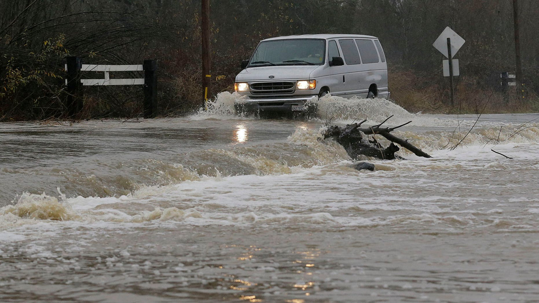 Jan. 7, 2017: A van drives through flooded water on Green Valley Road in Graton, Calif.