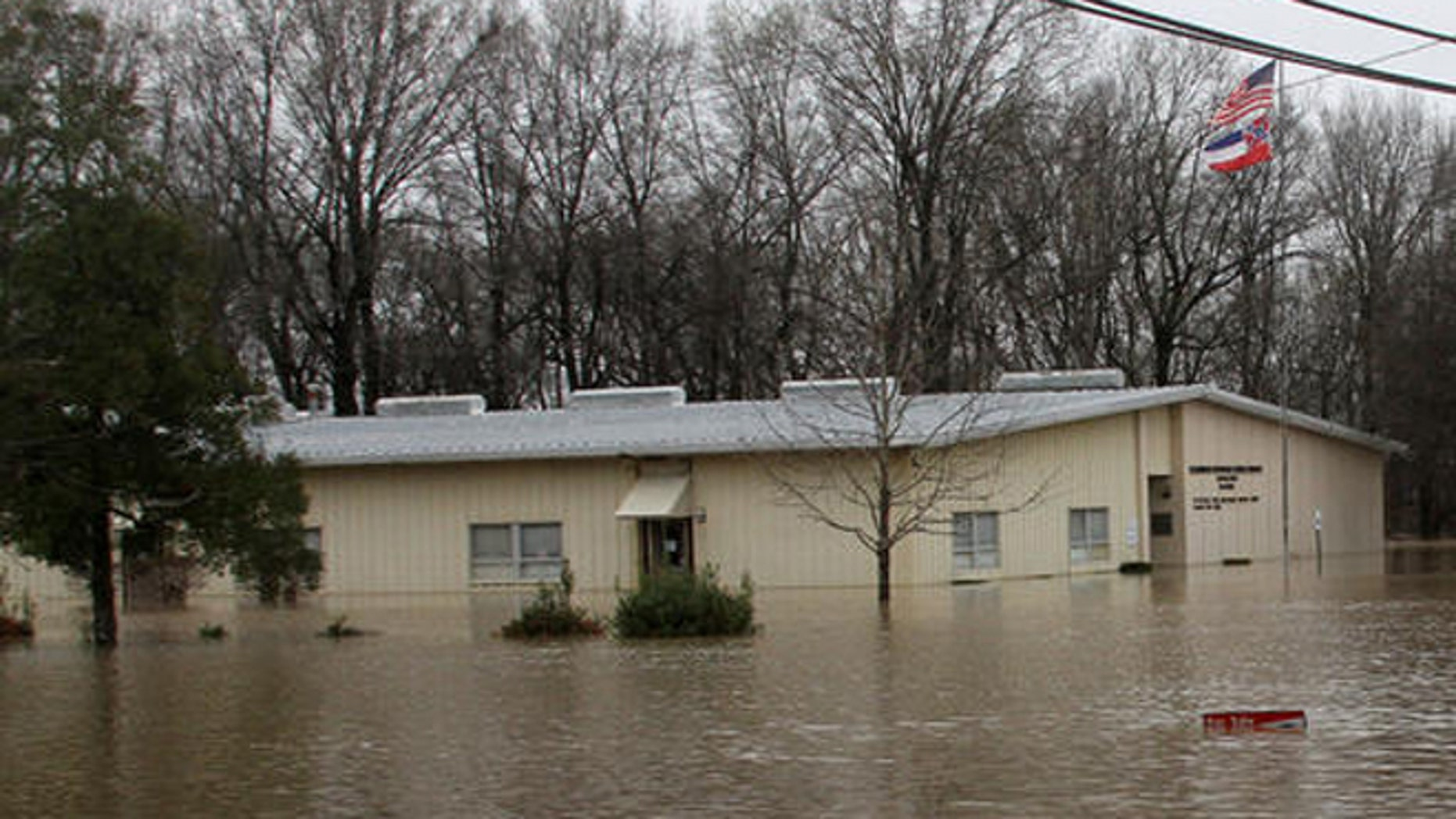The Clarksdale Municipal School District office is surrounded by several feet of floodwater, Friday, March 11, 2016, in Clarksdale, Mississippi. (Troy Catchings/The Clarksdale Press Register, via AP) MANDATORY CREDIT