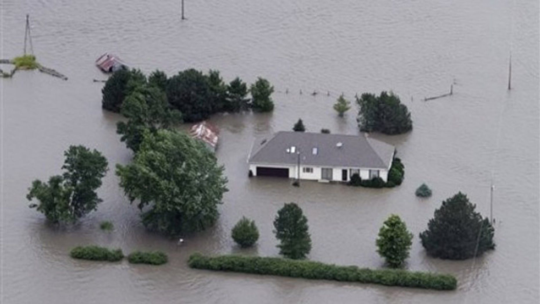 June 13: A home is engulfed by flood water in Hamburg, Iowa. The rising Missouri River has ruptured two levees in northwest Missouri, sending torrents of floodwaters over rural farmland toward the Iowa town of Hamburg and the Missouri resort town of Big Lake.