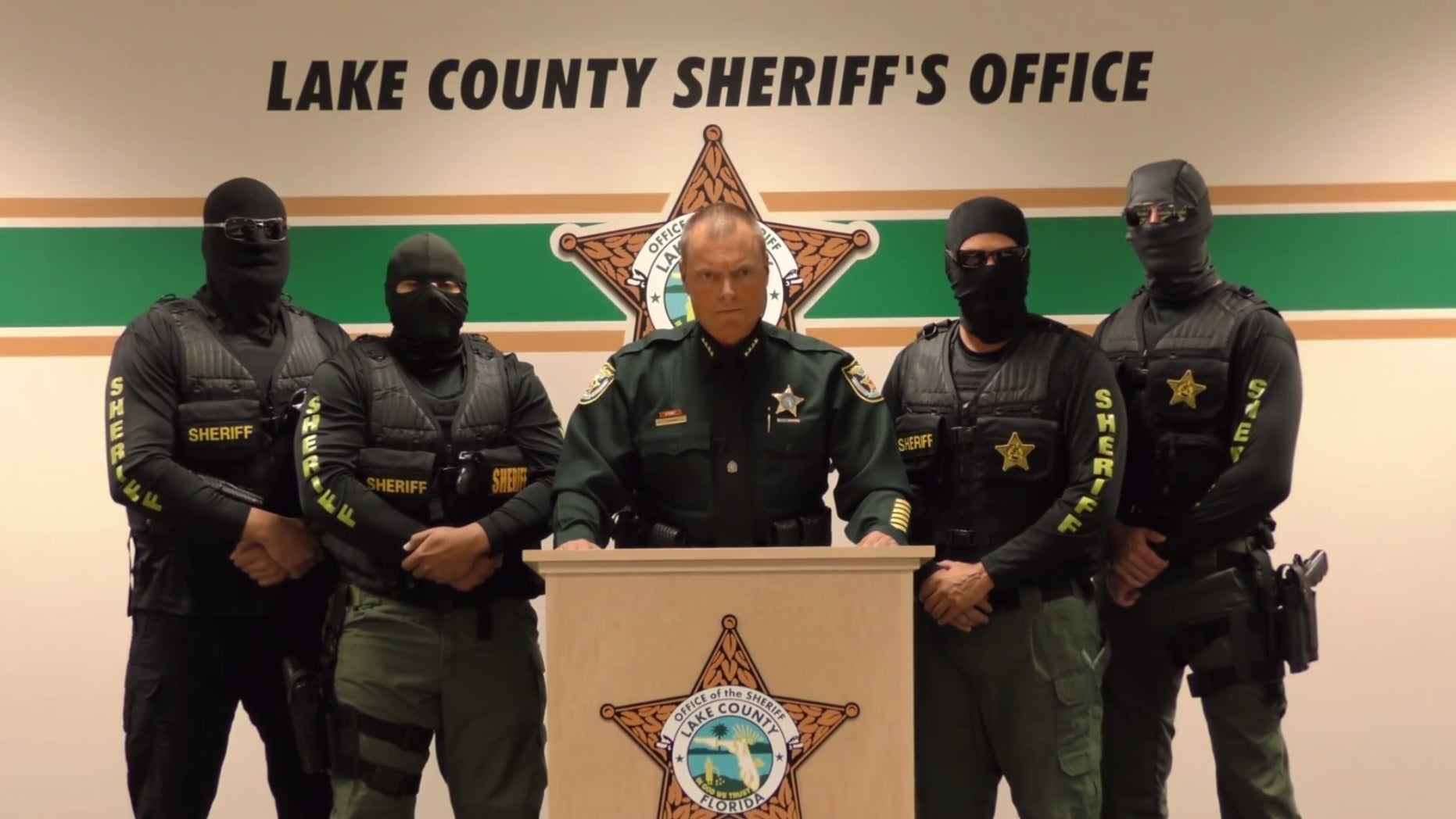 Lake County Sheriff Peyton Grinnell with masked agents in the video.