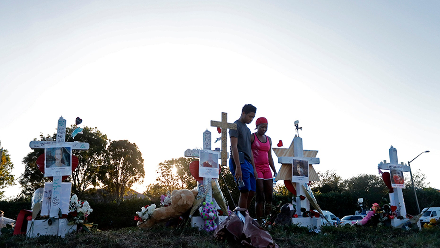 People visiting a makeshift memorial outside Marjory Stoneman Douglas High School, where 17 people were killed on Feb. 14.