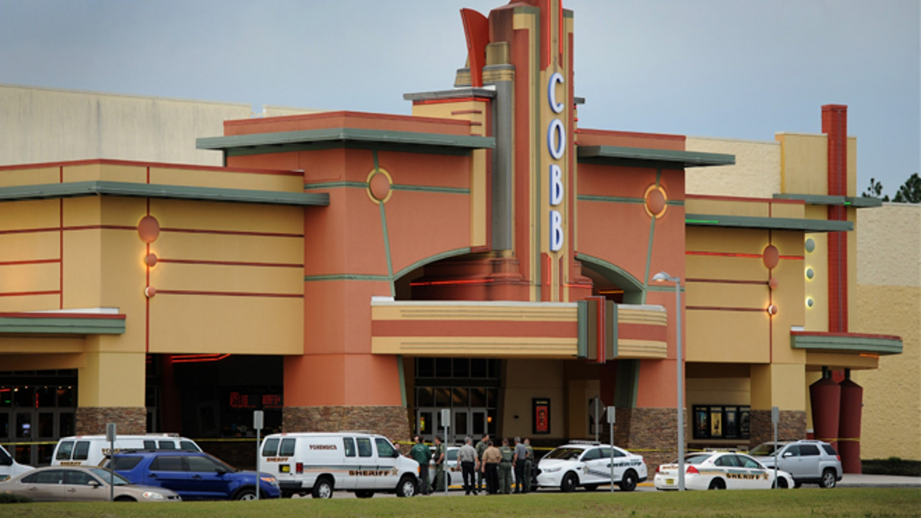 Jan. 13, 2014: Authorities stand outside Cobb Theater after a shooting in Wesley Chapel, Fla.