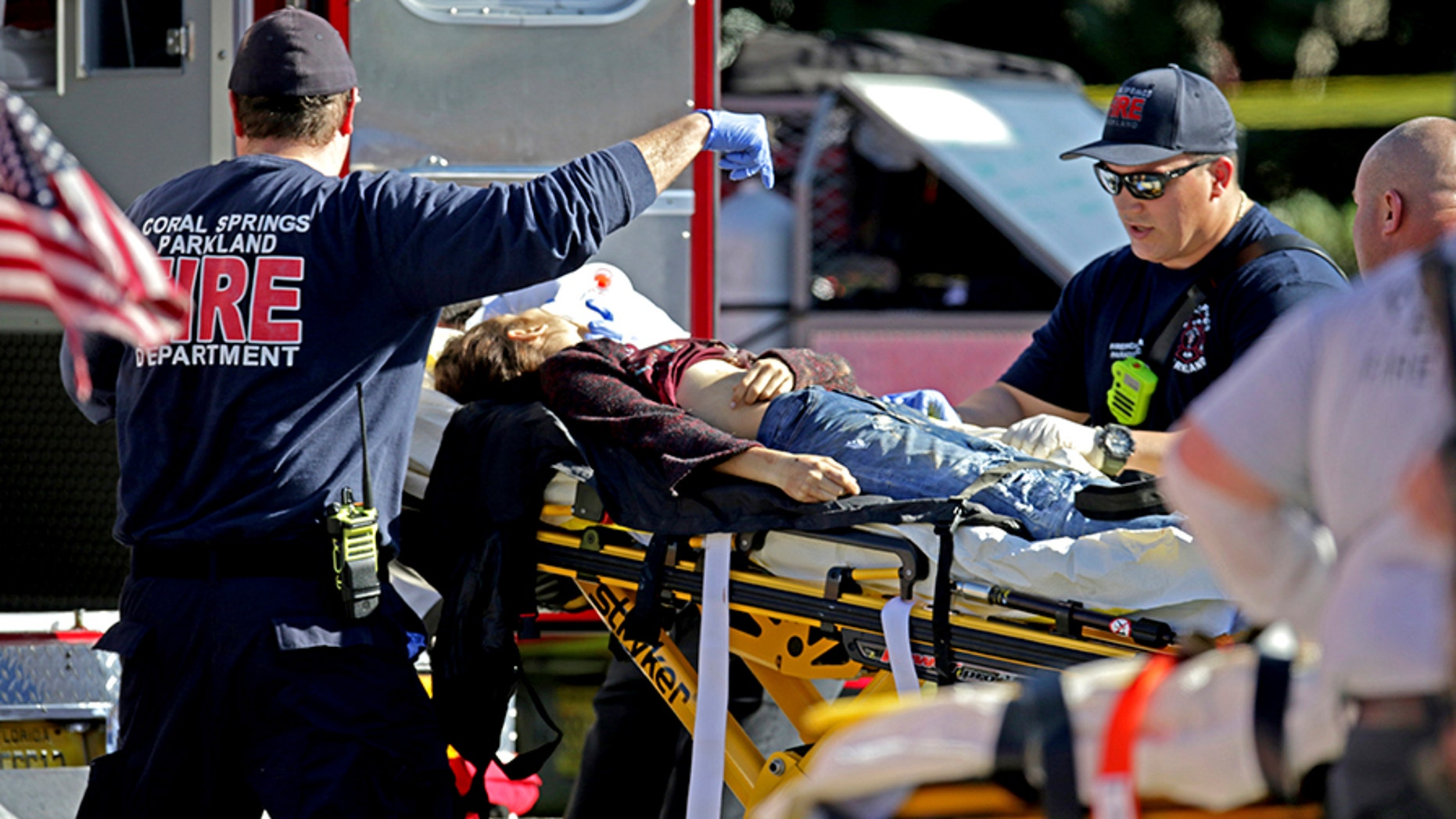 Medical personnel tend to victim following a shooting at Marjory Stoneman Douglas School in Parkland, Florida.