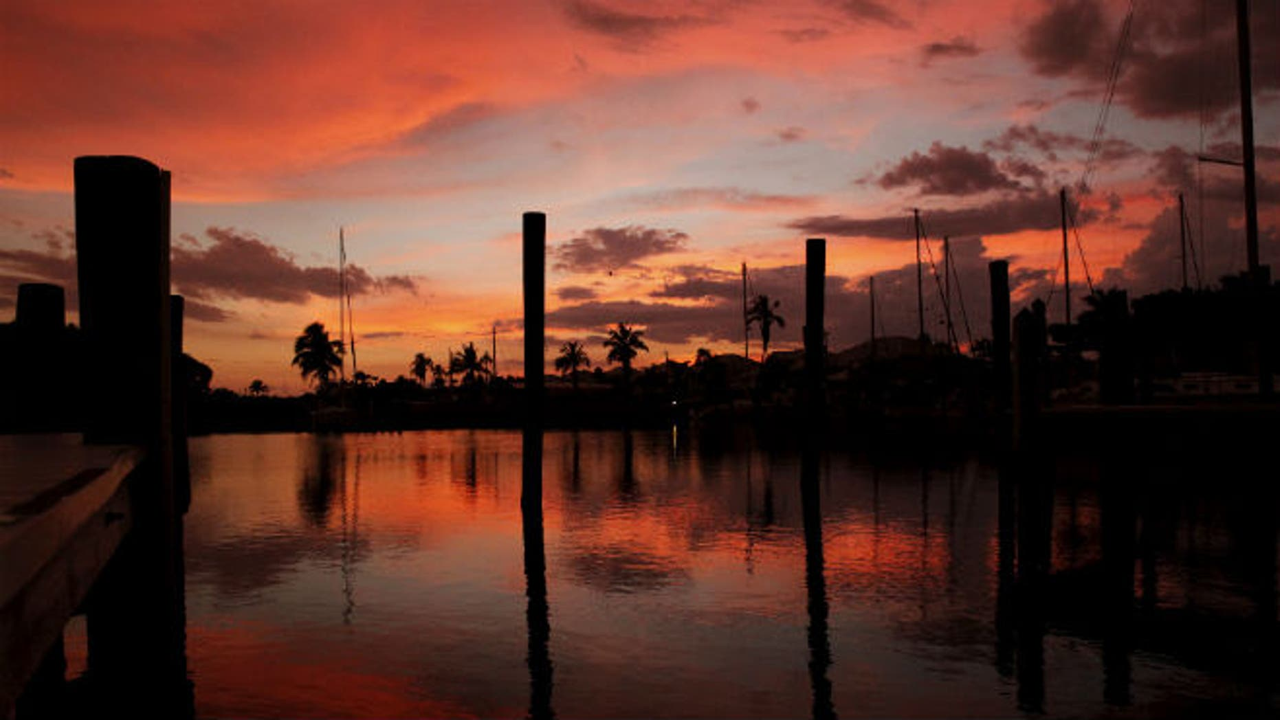 The sun sets over a marina in Fort Myers Beach, Florida June 20, 2015. REUTERS/Jim Bourg