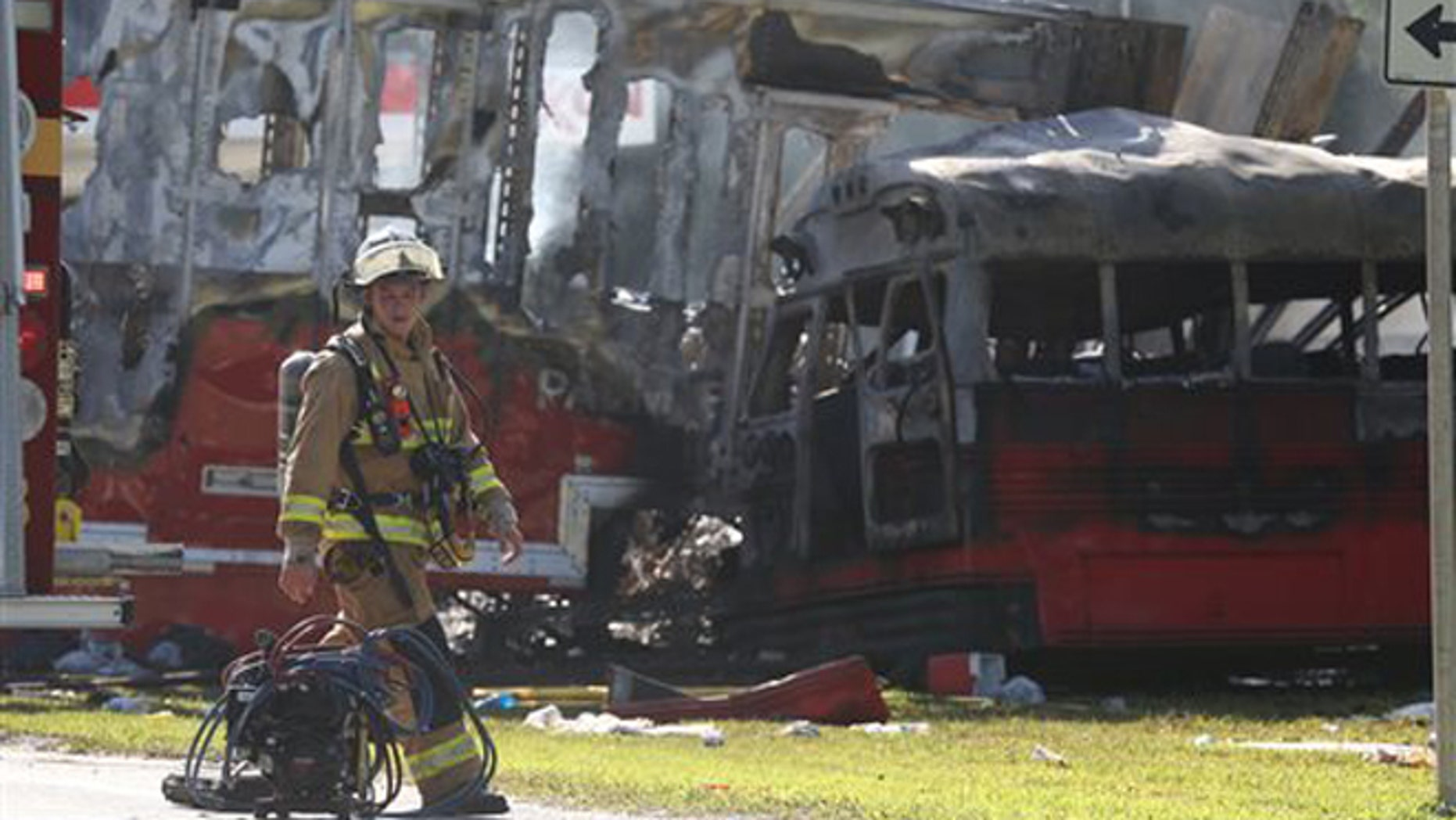 Wakulla County first responders work on the scene of an accident on Saturday, July 2, 2016 in Wakulla, Fla.