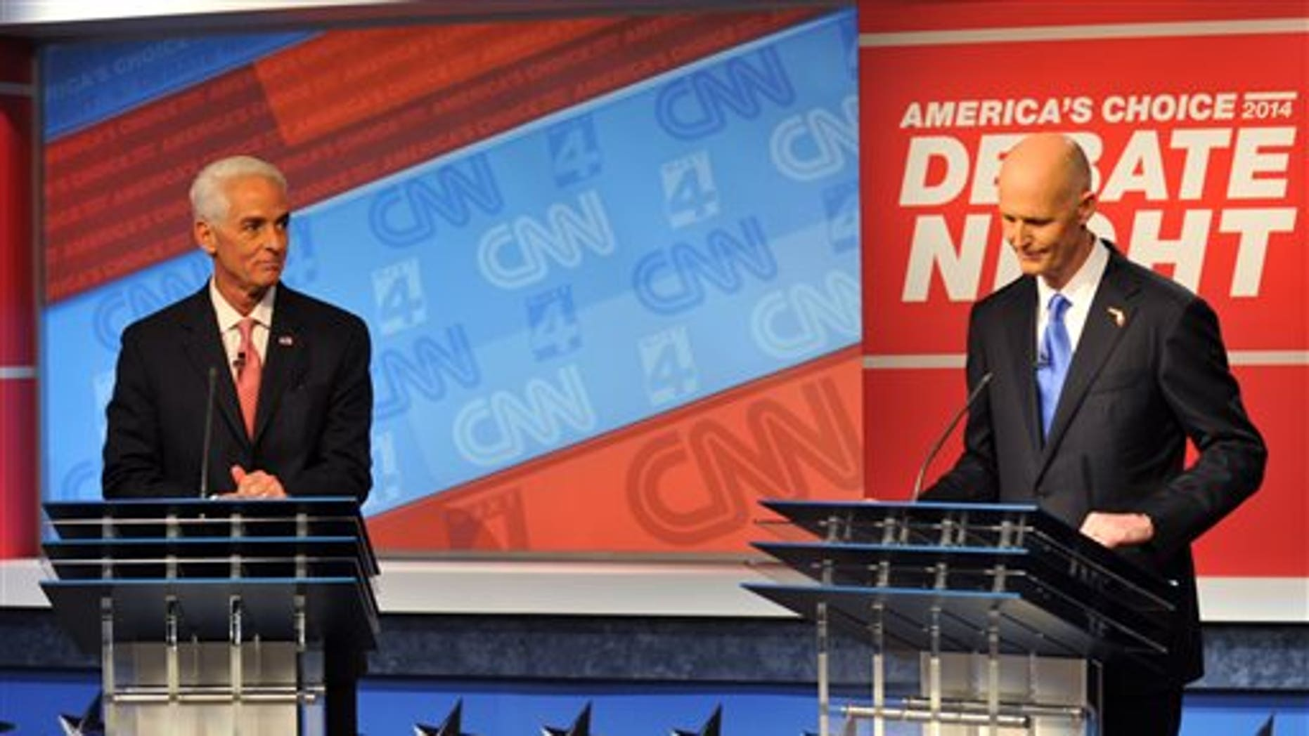 Oct. 21, 2014: Democratic candidate Charlie Crist, left, and Republican Gov. Rick Scott wait for their live televised debate.