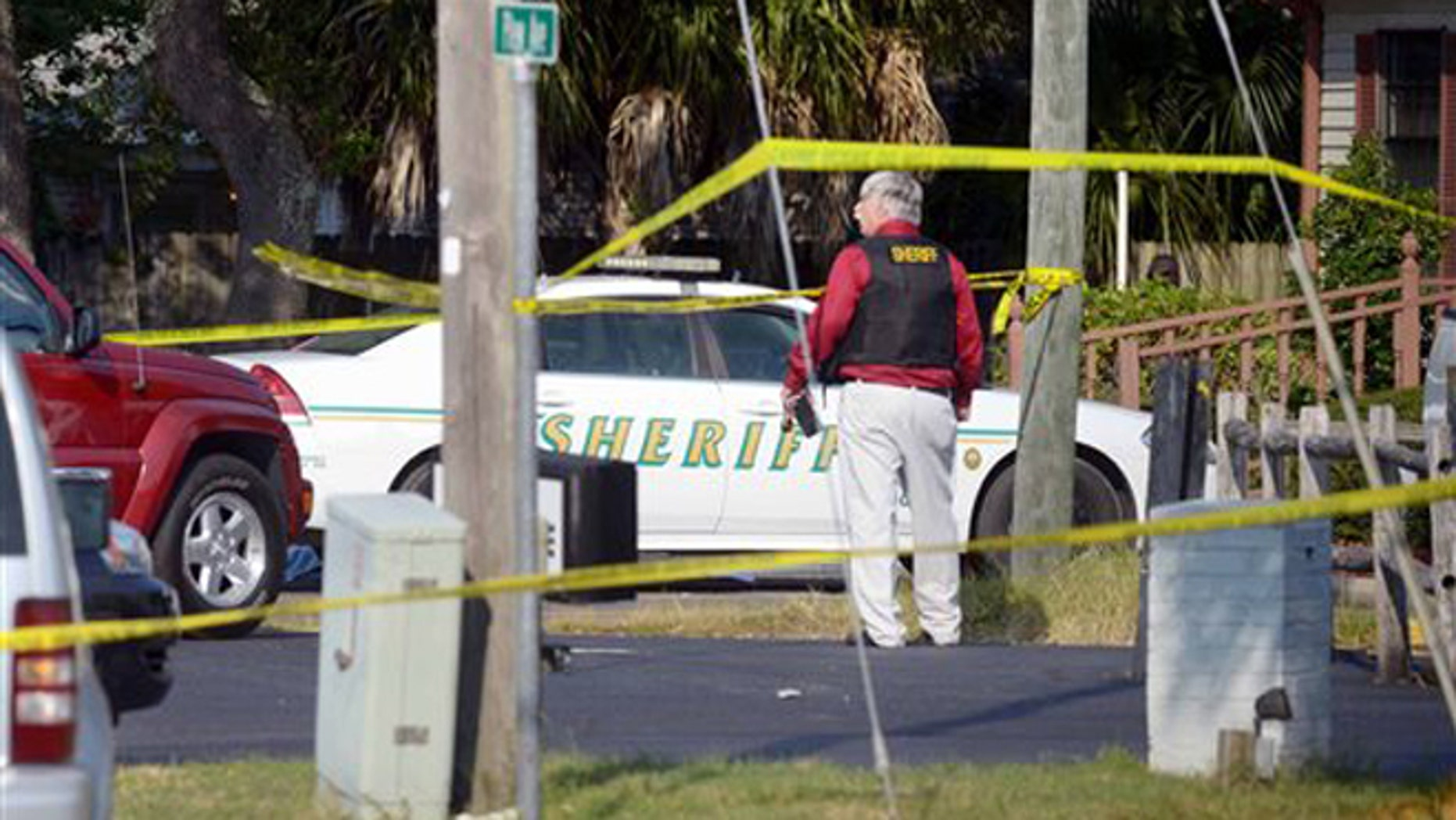 Sept. 22, 2015: Okaloosa Sheriff's Office personnel work at the scene of of a law office in Shalimar, Florida where a sheriff's deputy was shot by a man who later fled to the nearby town of Niceville and barricaded himself in a hotel before exchanging gunfire with deputies.