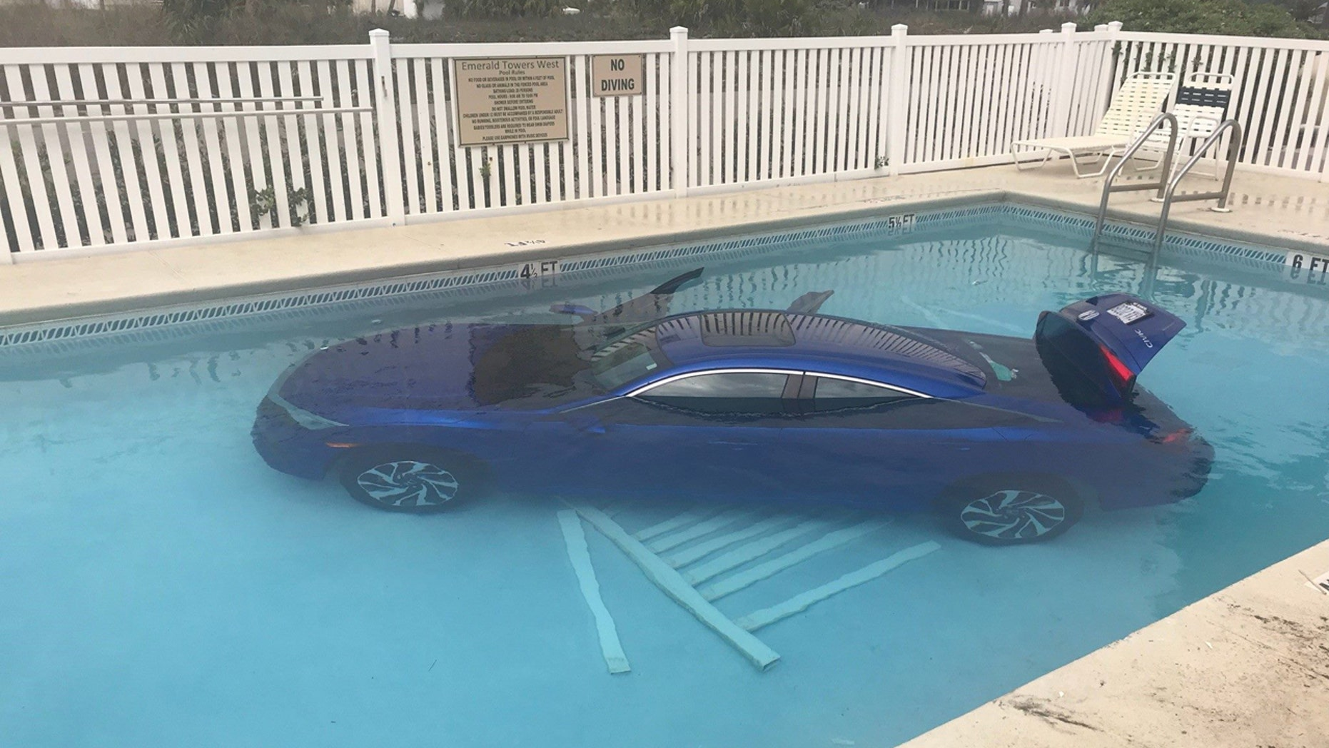 A Honda Civic with a man and child inside ended up in a pool on Tuesday after a woman failed to put the car into park.