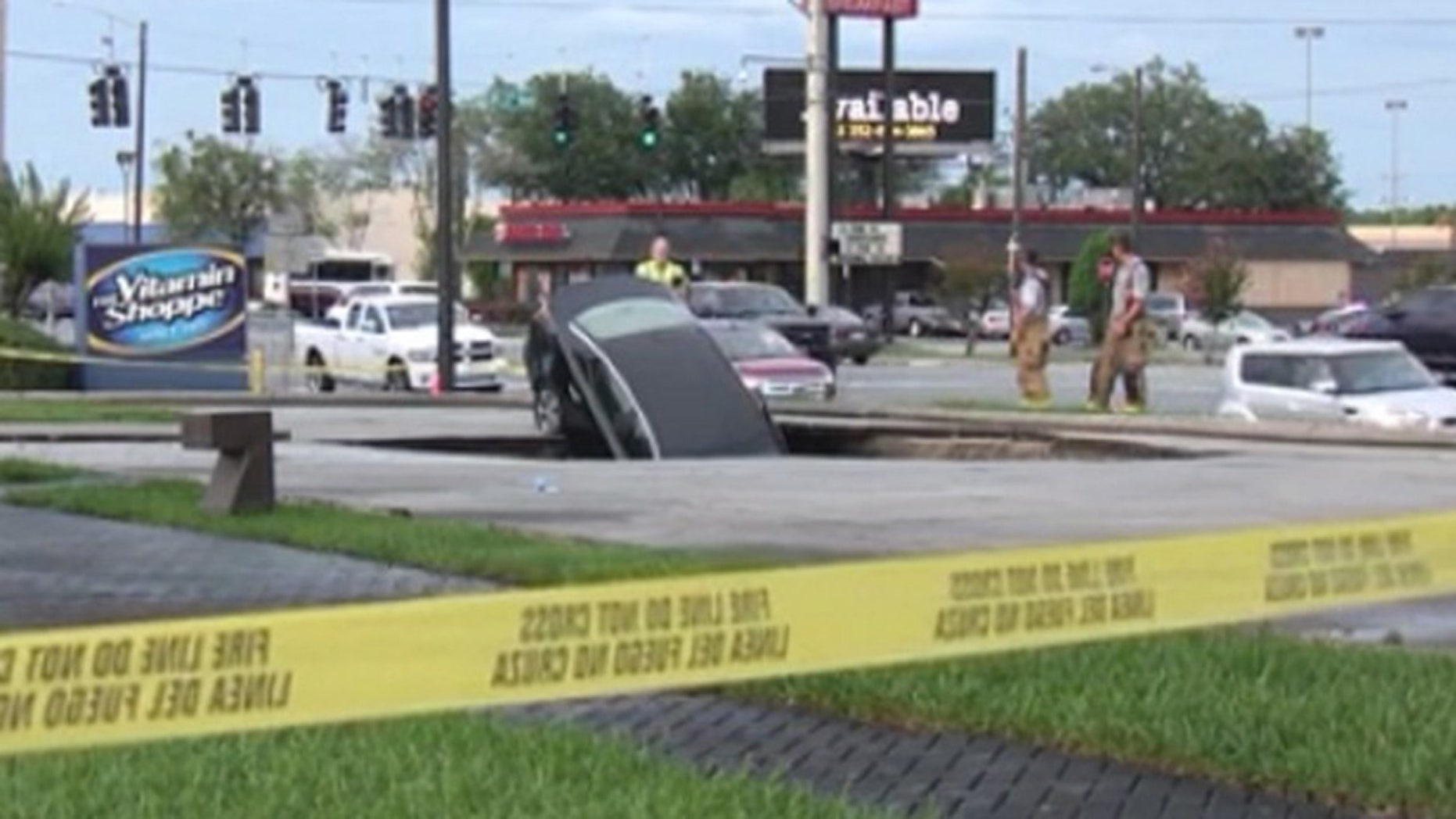 A sinkhole in Marion County swallowed a car, according to the Ocala Fire Department.