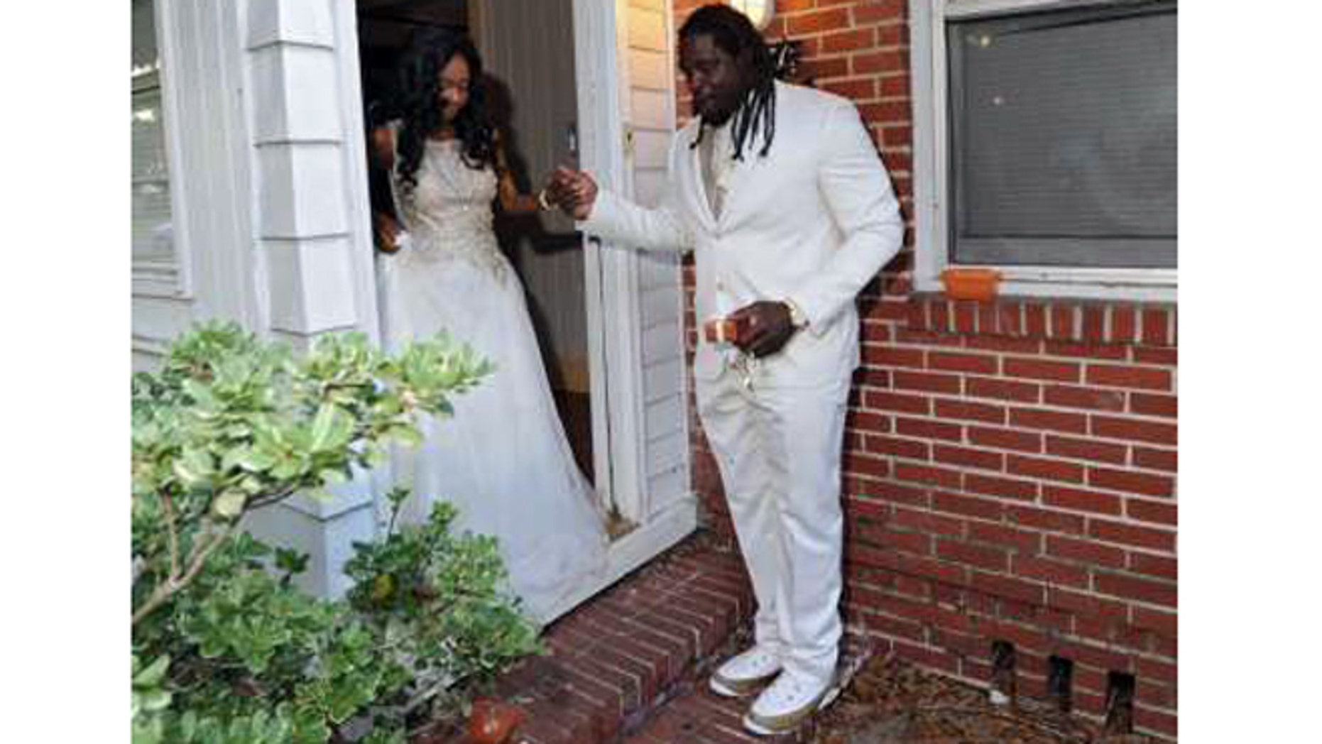 Jaguars defensive tackle Sen'Derrick Marks helps 18-year-old Khameyea Jennings, a cancer patient at Wolfson Children's Hospital, walk down her steps at home on the way to her senior prom. (Bob Mack/The Florida Times-Union)