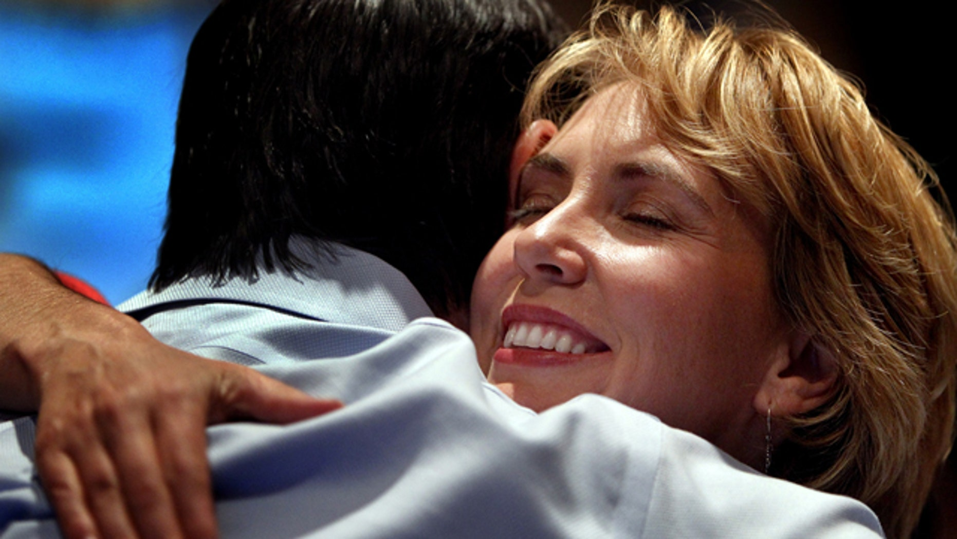 Nov. 2, 2010: U.S. Rep. Gabrielle Giffords gets a hug from a supporter at the Pima County Democratic election party at the Tucson Marriott in Tucson, Ariz. Authorities say that Giffords was shot in the head while meeting with constituents