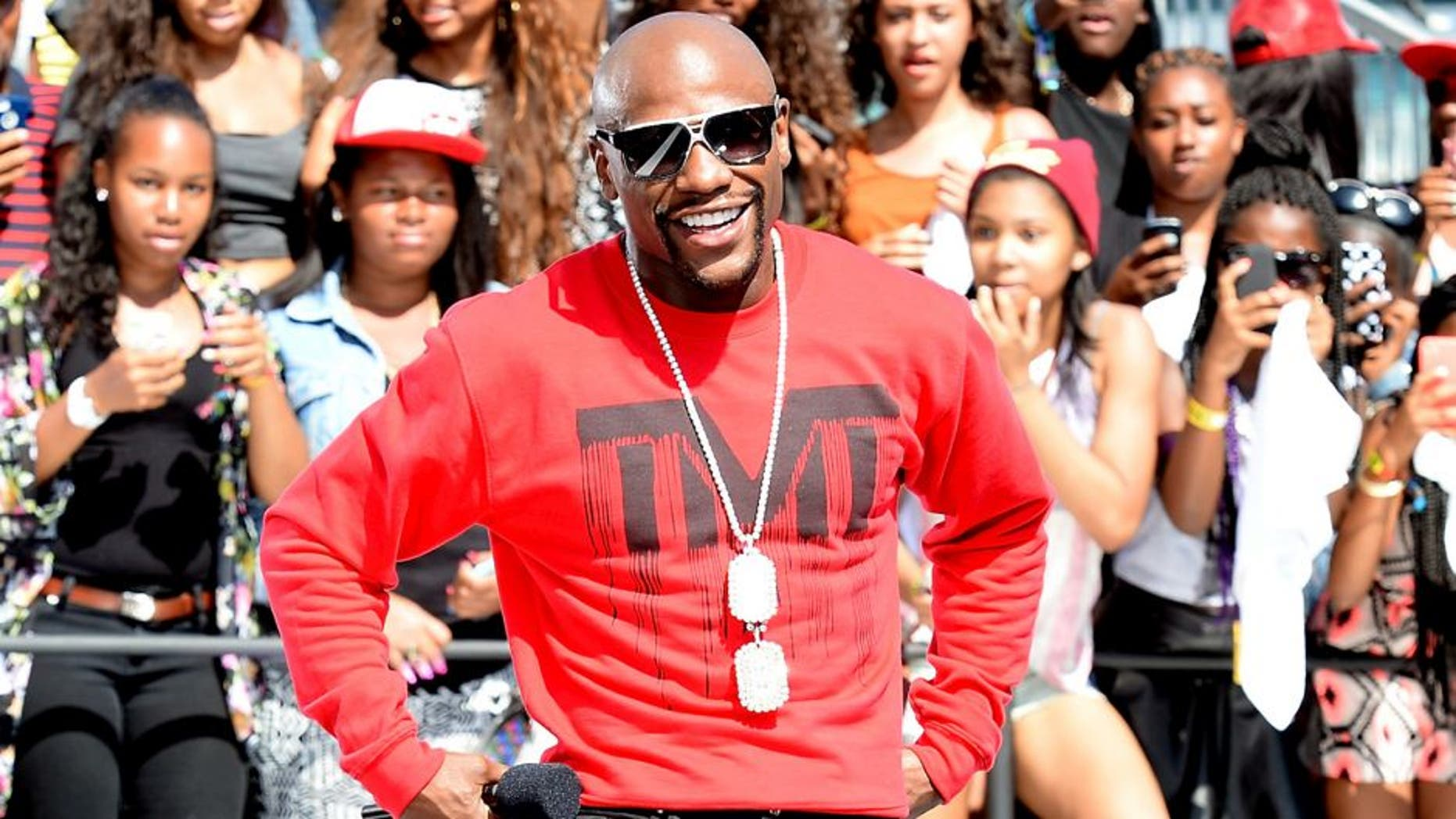 LOS ANGELES, CA - JUNE 28: Professional boxer Floyd Mayweather Jr. speaks onstage at 106 & Park Live Presented By Coca Cola during the 2014 BET Experience at L.A. LIVE on June 28, 2014 in Los Angeles, California. (Photo by Earl Gibson/BET/Getty Images for BET)