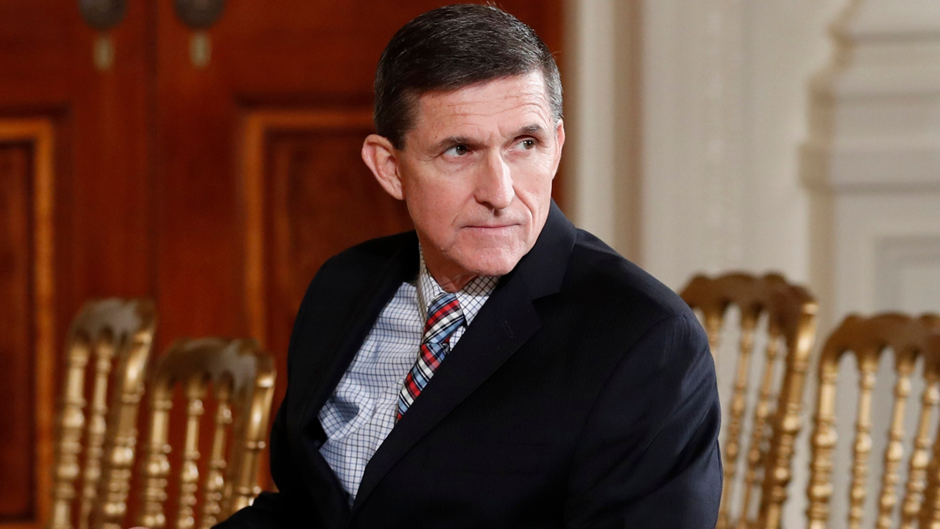 FILE - In this Feb. 10, 2017 file photo, then-National Security Adviser Michael Flynn sits in the East Room of the White House in Washington.  A member of Donald Trump's transition team asked national security officials in the Obama White House for the classified CIA profile on Russia's ambassador to the United States. The unusual request appears to signal that Trump's own team had concerns about whether his pick for national security adviser, Mike Flynn, fully understood that he was dealing with a man rumored to have ties to Russian intelligence agencies. (AP Photo/Carolyn Kaster, File)