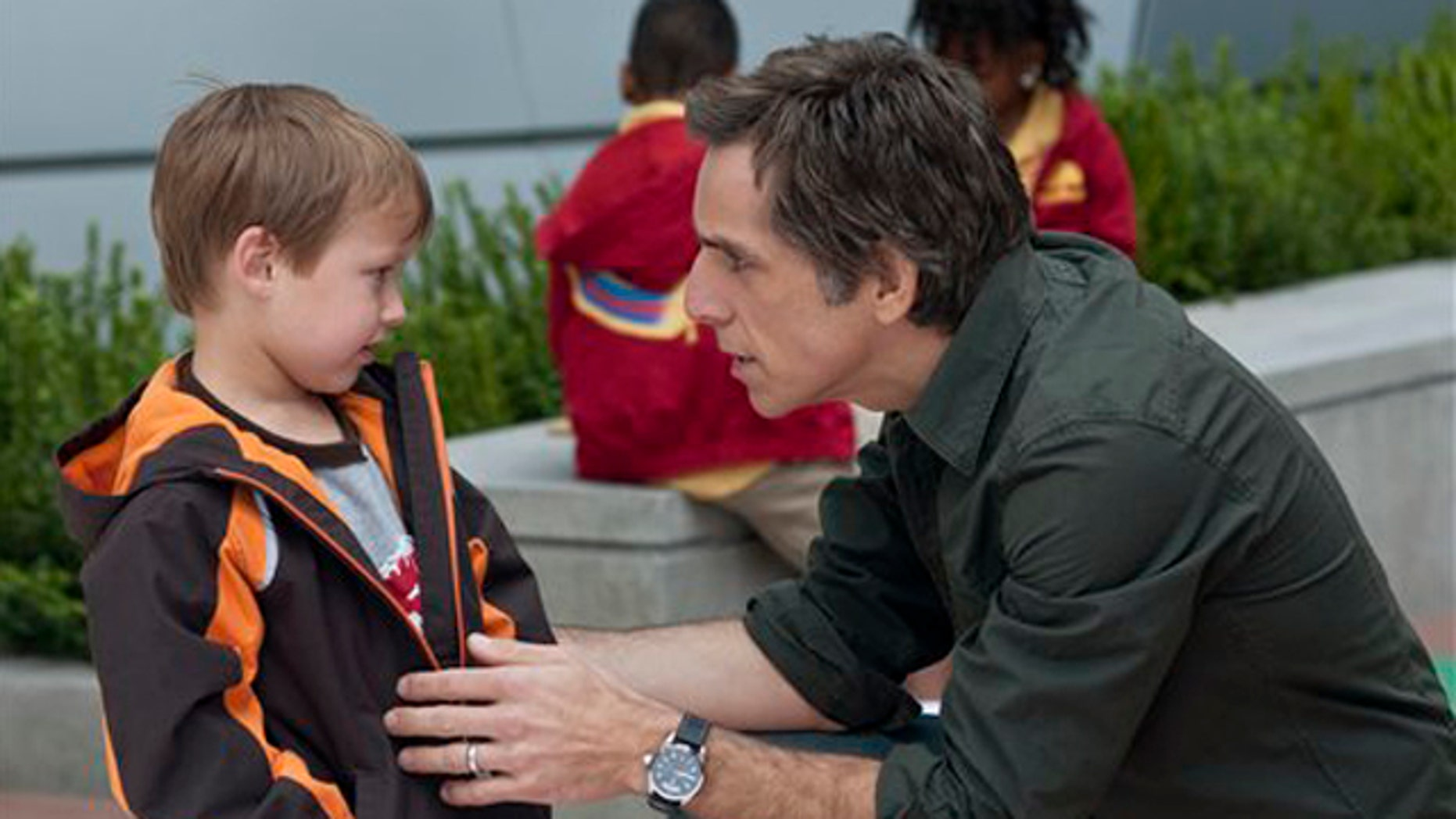 "In this film publicity image released by Universal Pictures, Colin Baiocchi, left, and Ben Stiller are shown in a scene from ""Little Fockers."""