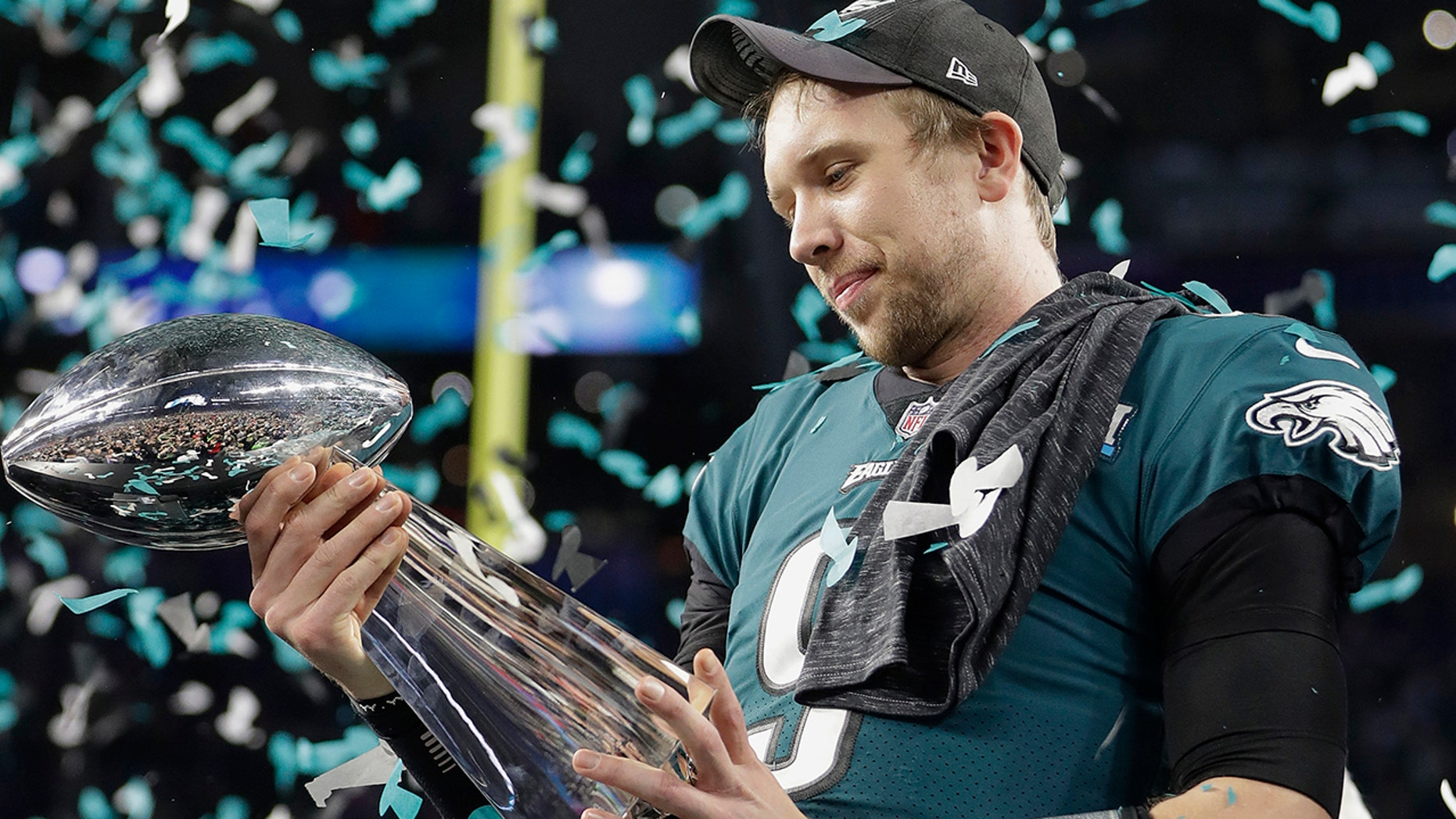 Philadelphia Eagles' Nick Foles holds up the Vince Lombardi Trophy after the NFL Super Bowl 52 football game against the New England Patriots, Sunday, Feb. 4, 2018, in Minneapolis. The Eagles won 41-33. (AP Photo/Mark Humphrey)