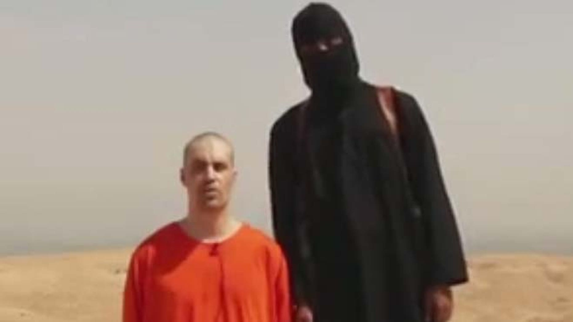 This undated image shows a frame from a video released by Islamic State militants that purports to show the killing of journalist James Foley by the militant group. Foley, from Rochester, N.H., disappeared in 2012 in northern Syria while on assignment for Agence France-Press and the Boston-based media company GlobalPost.
