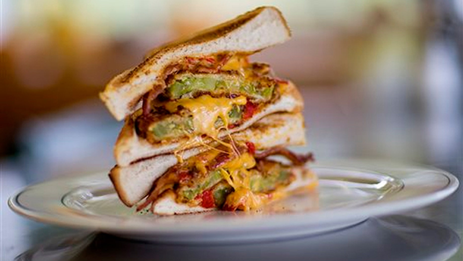 The Grant Stack, a sandwich made with Texas toast, fried green tomatoes, bacon and pimento cheese at the Home grown restaurant.
