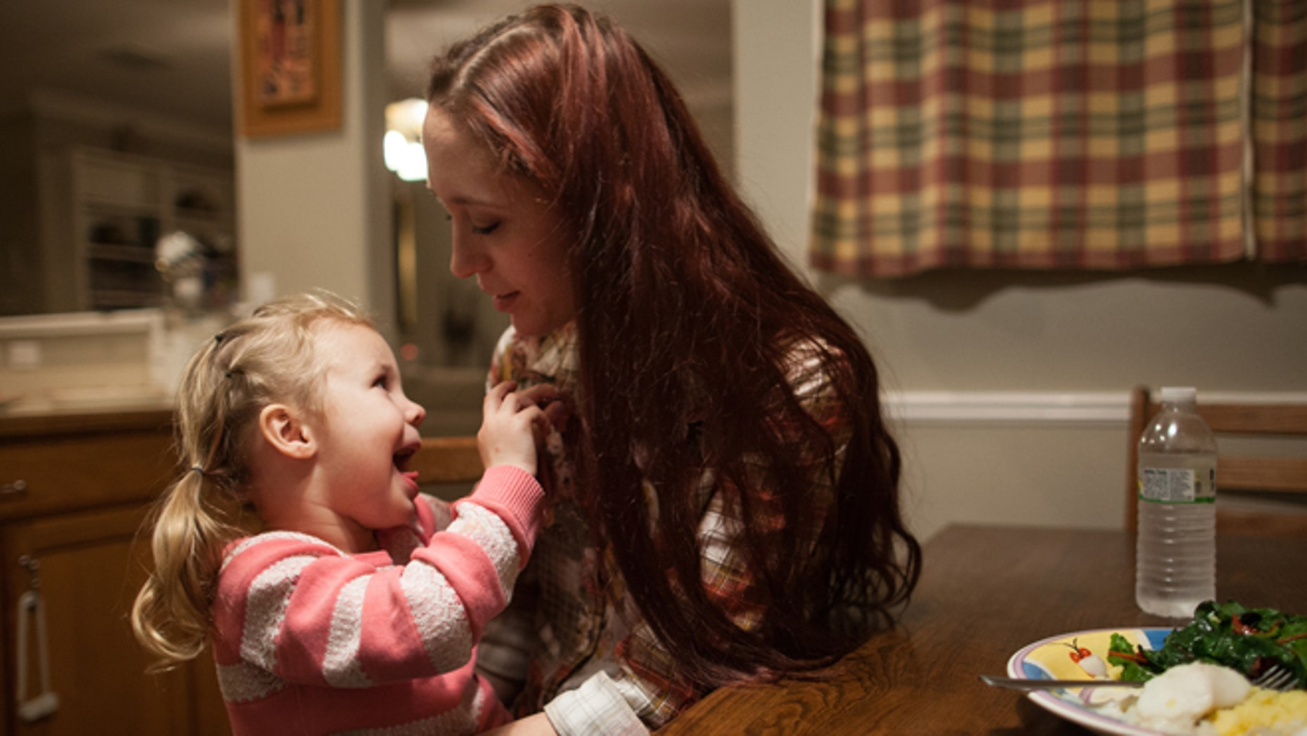 Jan. 25, 2014: Maggie Barcellano with daughter Zoe, 3, at her father's house in Austin, Texas.