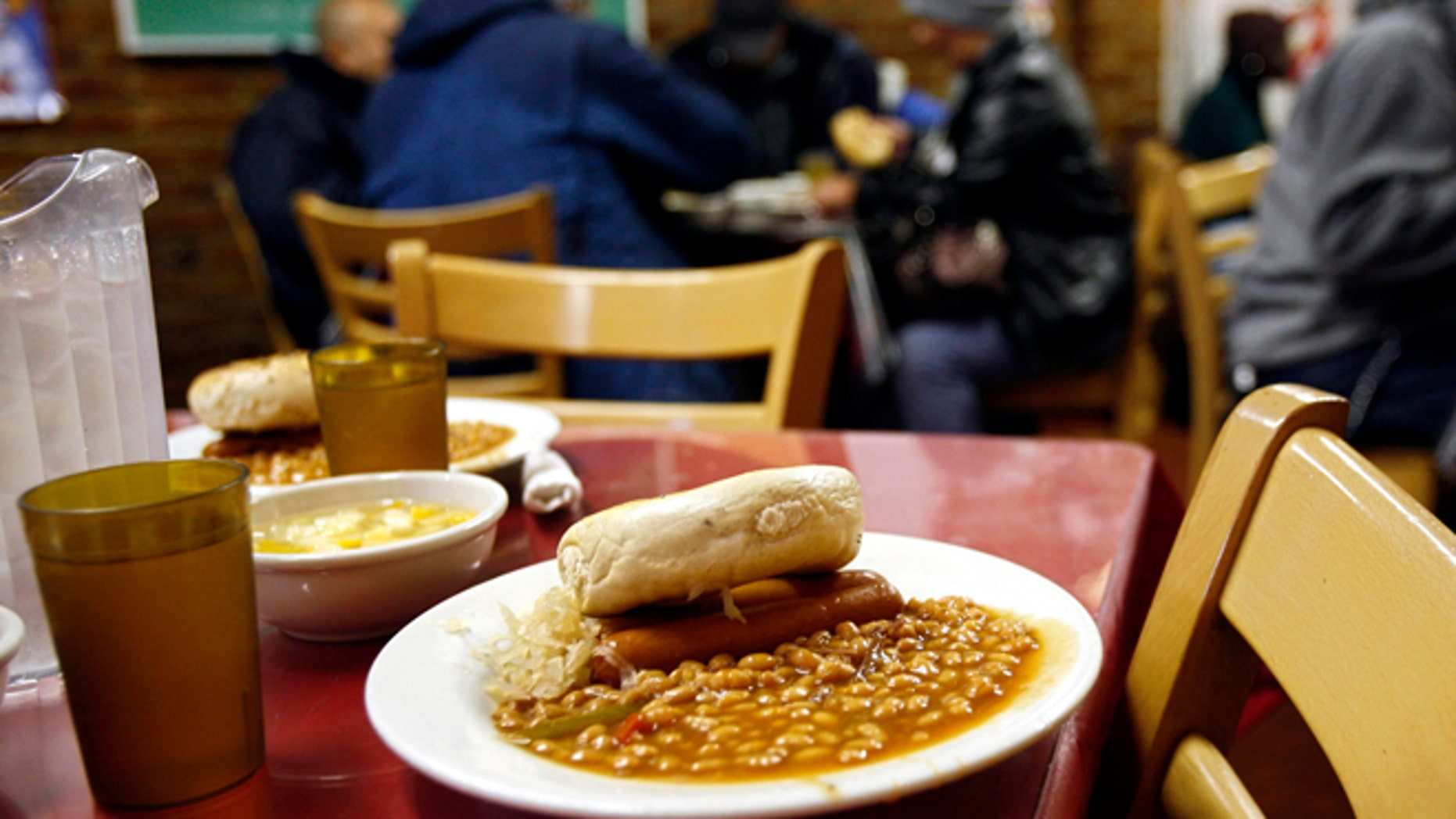 FILE: 2006: A lunch meal at the Part of the Solution soup kitchen and food pantry in the Bronx borough of New York. Nearly one in 10 Americans at the time were expected to rely on food stamps.
