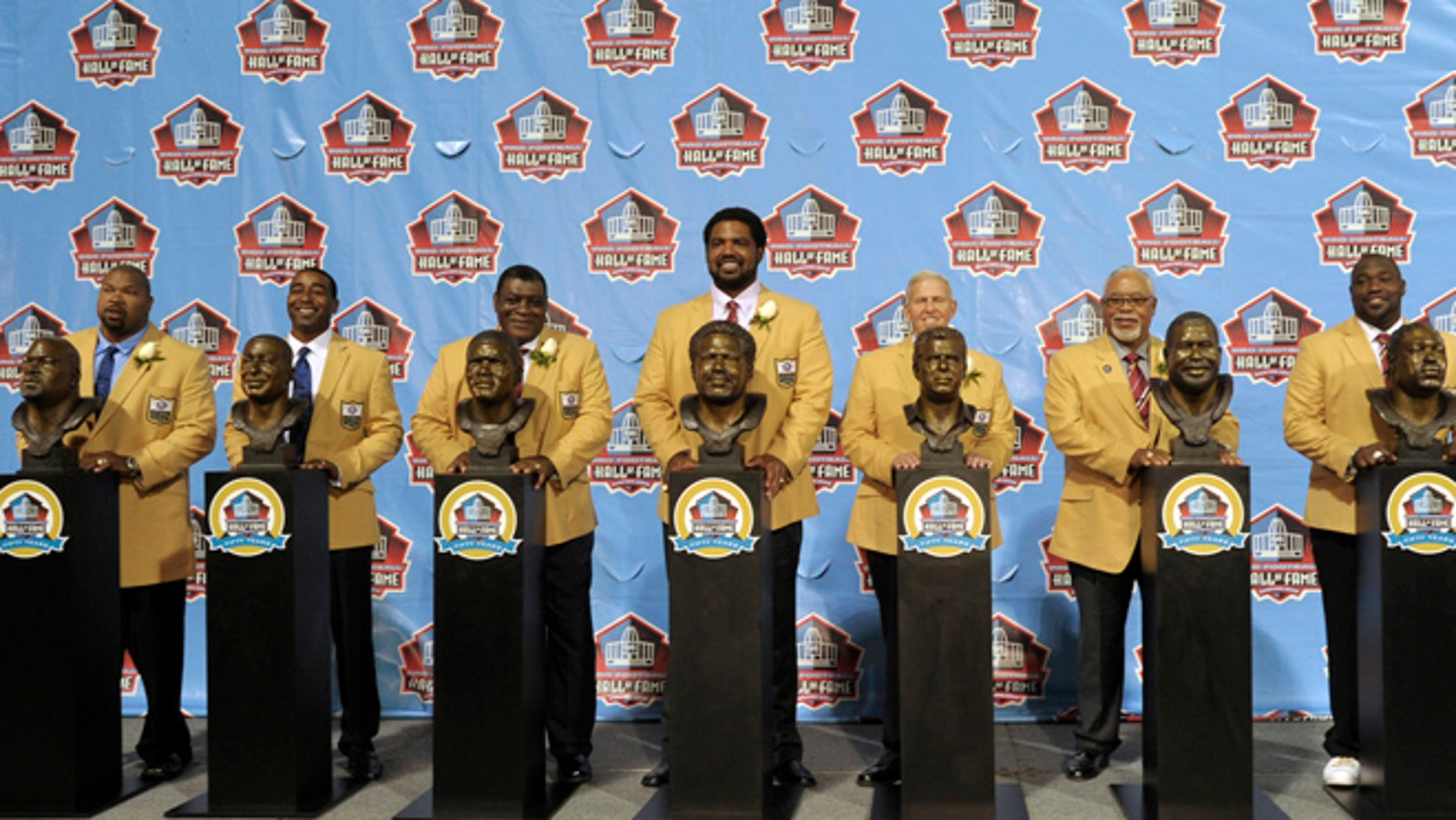 Aug. 3, 2013: Hall of Fame inductees, from left, Larry Allen, Cris Carter, Dave Robinson, Jonathan Ogden, Bill Parcells, Curley Culp and Warren Sapp pose with their bronze busts during the 2013 Pro Football Hall of Fame Induction Ceremony in Canton, Ohio.