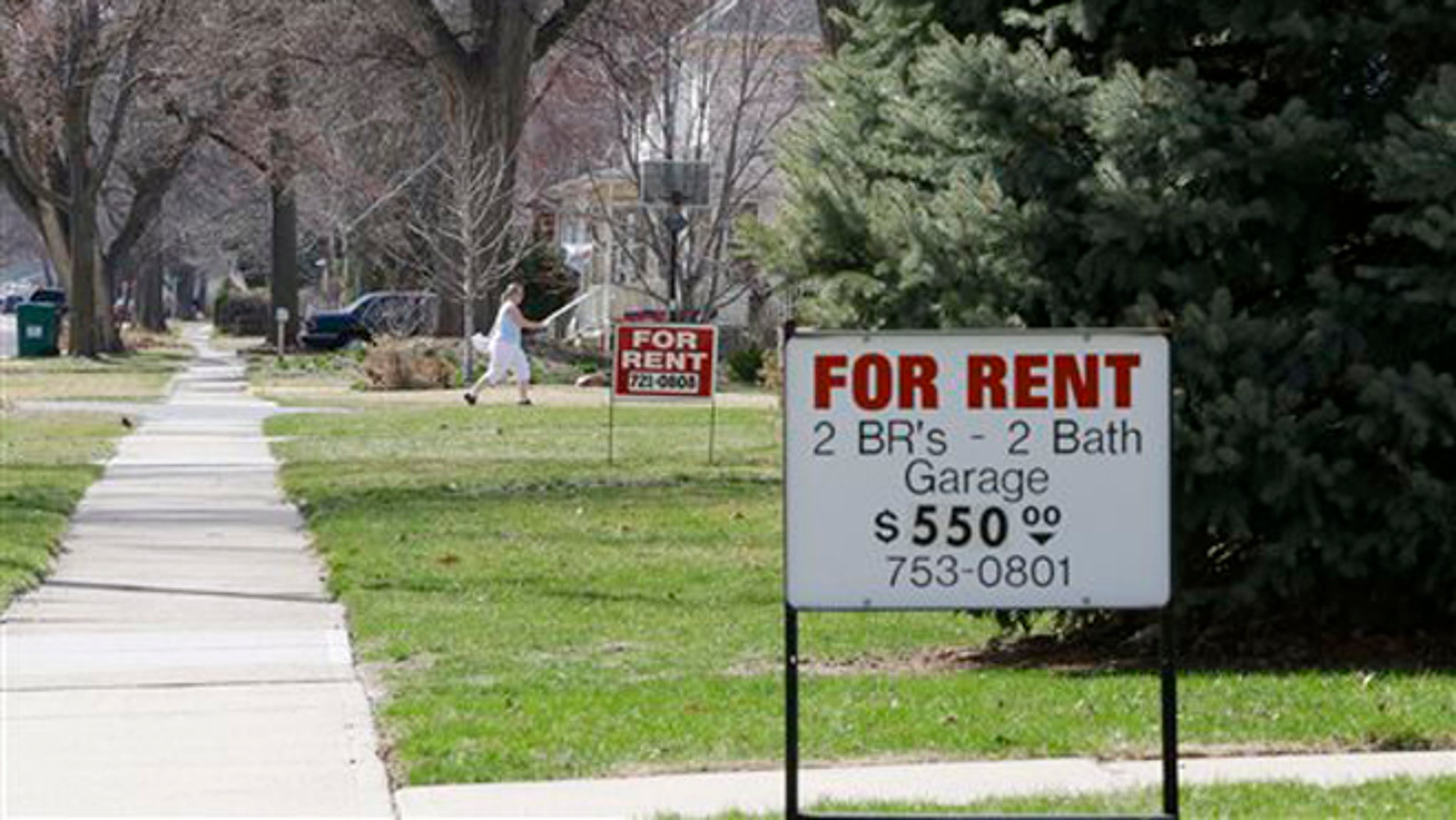 For Rent signs are seen in Fremont, Neb., Wednesday, April 9, 2014. Fremont police will begin issuing occupancy licenses to renters on Thursday, April 10, 2014, as part of the city's ordinance aimed at combating illegal immigration. (AP Photo/Nati Harnik)