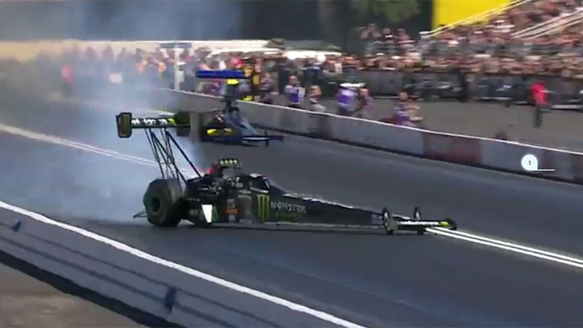 Emergency crews help Force from her Top Fuel dragster.