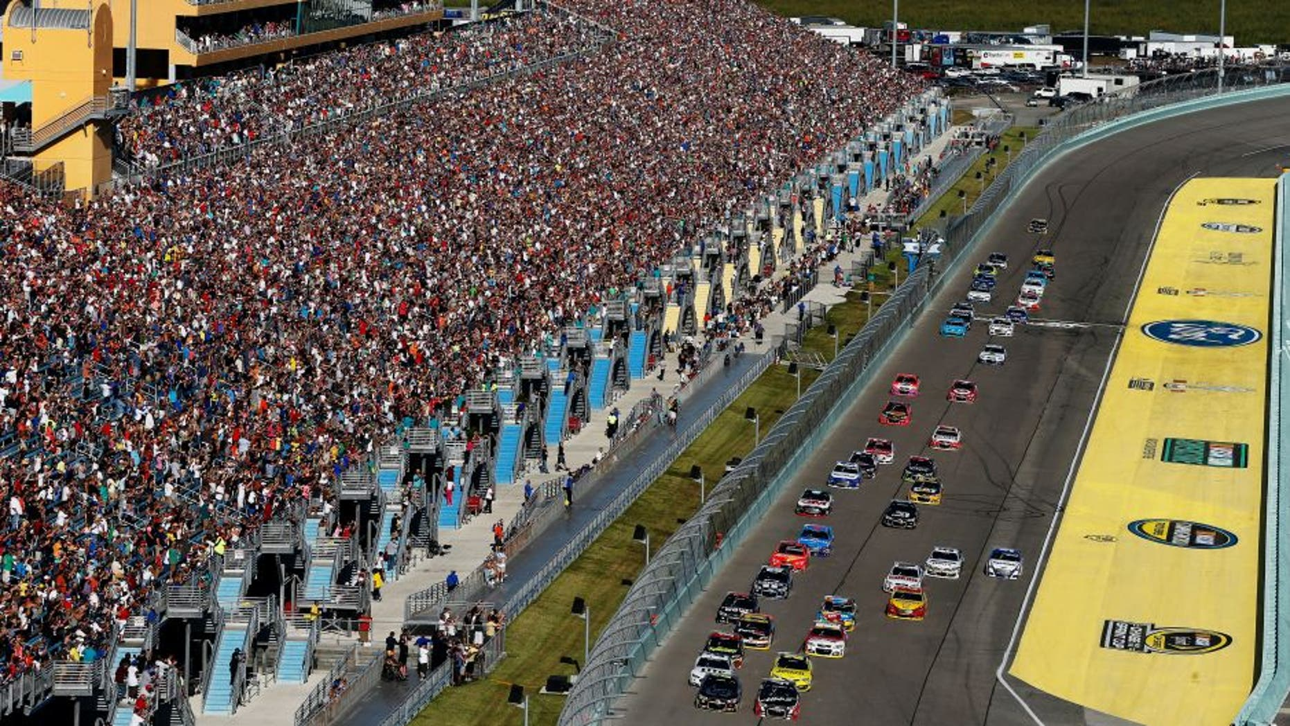 HOMESTEAD, FL - NOVEMBER 16: Jeff Gordon, driver of the #24 Drive To End Hunger Chevrolet, and Kurt Busch, driver of the #41 Haas Automation Chevrolet, lead the field on the first lap of the NASCAR Sprint Cup Series Ford EcoBoost 400 at Homestead-Miami Speedway on November 16, 2014 in Homestead, Florida. (Photo by Brian Lawdermilk/Getty Images)