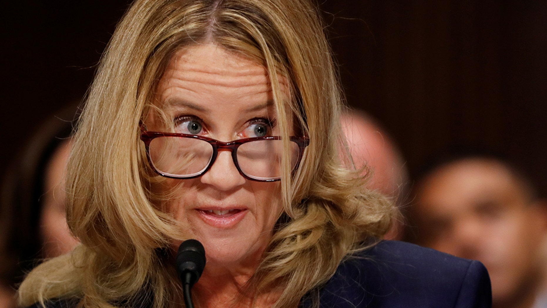 Professor Christine Blasey Ford, who has accused U.S. Supreme Court nominee Brett Kavanaugh of a sexual assault in 1982, listens while testifying before a Senate Judiciary Committee confirmation hearing for Kavanaugh on Capitol Hill in Washington, U.S., September 27, 2018.