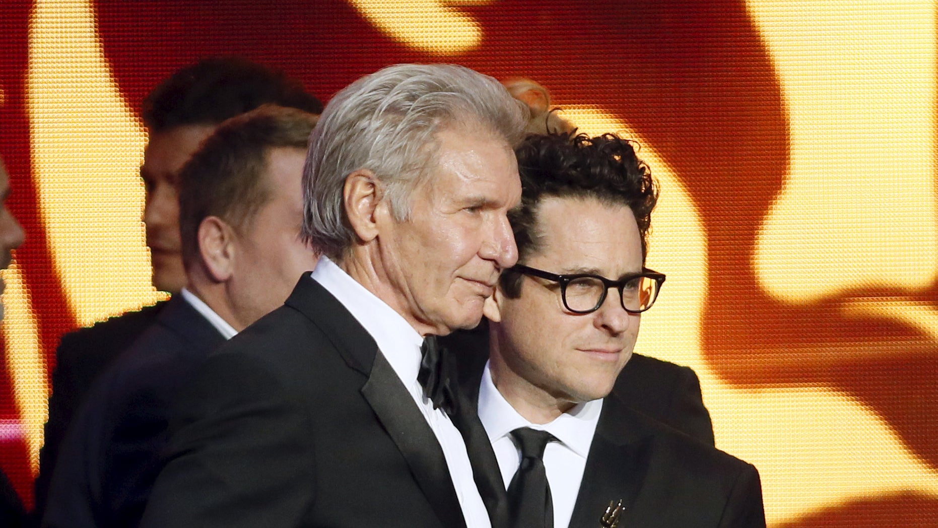 October 30, 2015. Actor Harrison Ford (L) poses with director J.J. Abrams during the British Academy Britannia Awards hosted by BAFTA Los Angeles in Beverly Hills, California.