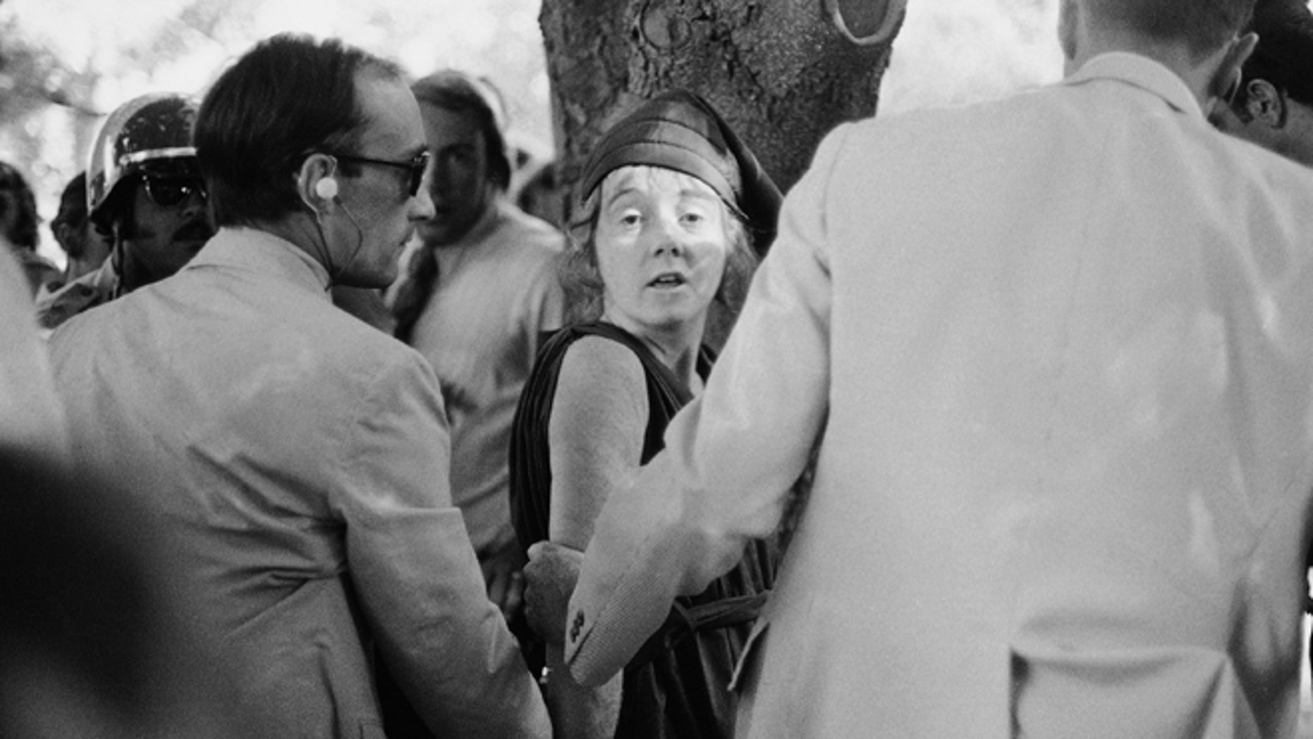 "Sept. 5, 1975 file photo shows Secret Service agents put handcuffs on Lynette ""Squeaky"" Fromme after she pointed at President Gerald Ford, in Sacramento, Calif."