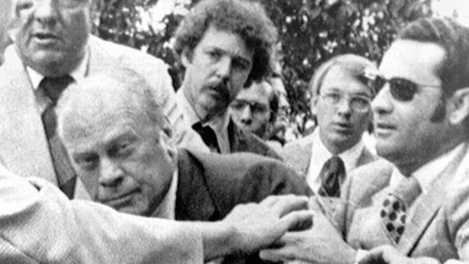 "FILE: Sept. 15, 1975: President Gerald Ford is shielded by the Secret Service after an assassination attempt by Lynette ""Squeaky"" Fromme. President Ford had spoken at a ""Host Breakfast,"" and was walking to California's state Capitol in Sacramento, Calif."