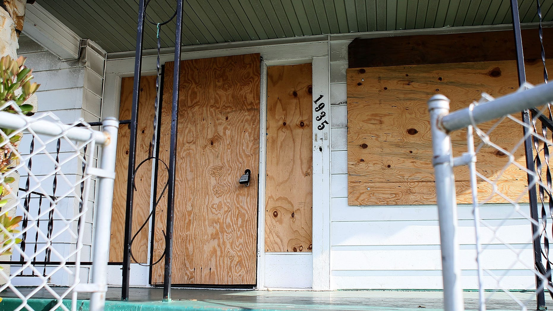 RICHMOND, CA - APRIL 15:  Windows and doors of a foreclosed home are covered with plywood April 15, 2010 in Richmond, California.