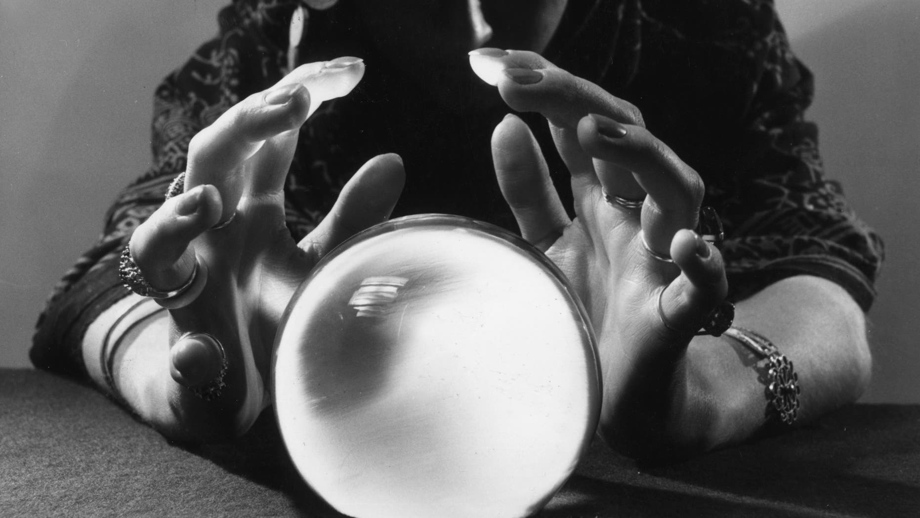 A gypsy fortune-teller gazing into her crystal ball.