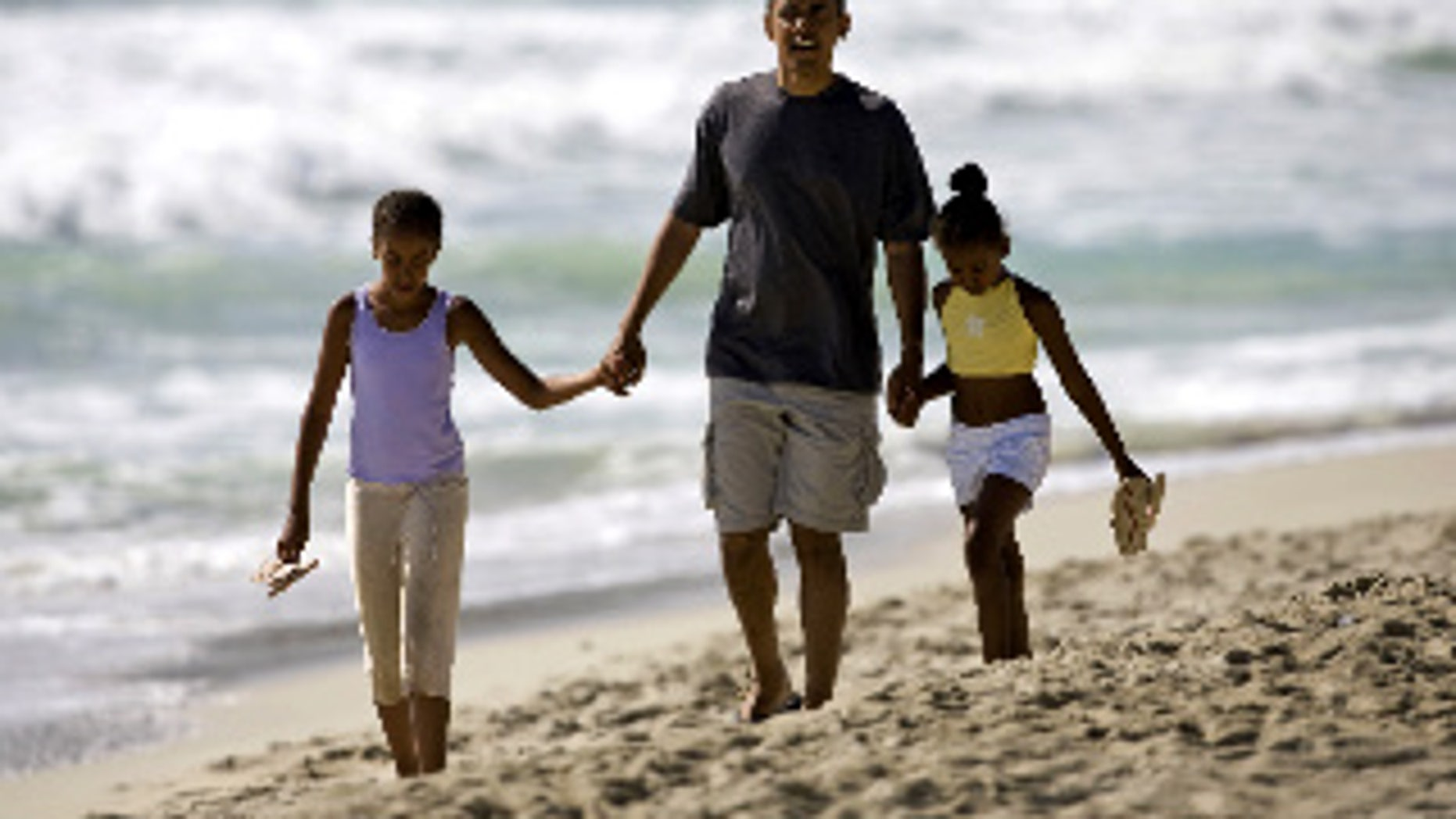 Obama and his daughters in Hawaii