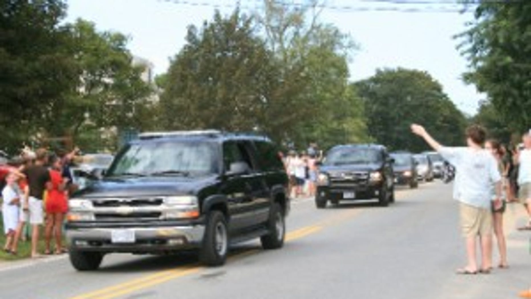 The President's motorcade makes its way past supporters. Fox Photo by Janice Haefeli