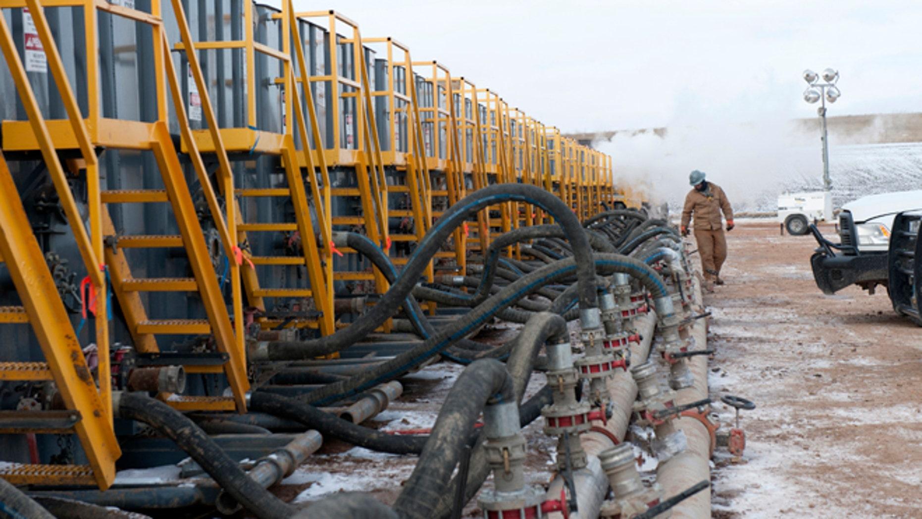 This Nov. 12, 2014 file photo shows water tanks at fracking site near Williston, North Dakota.
