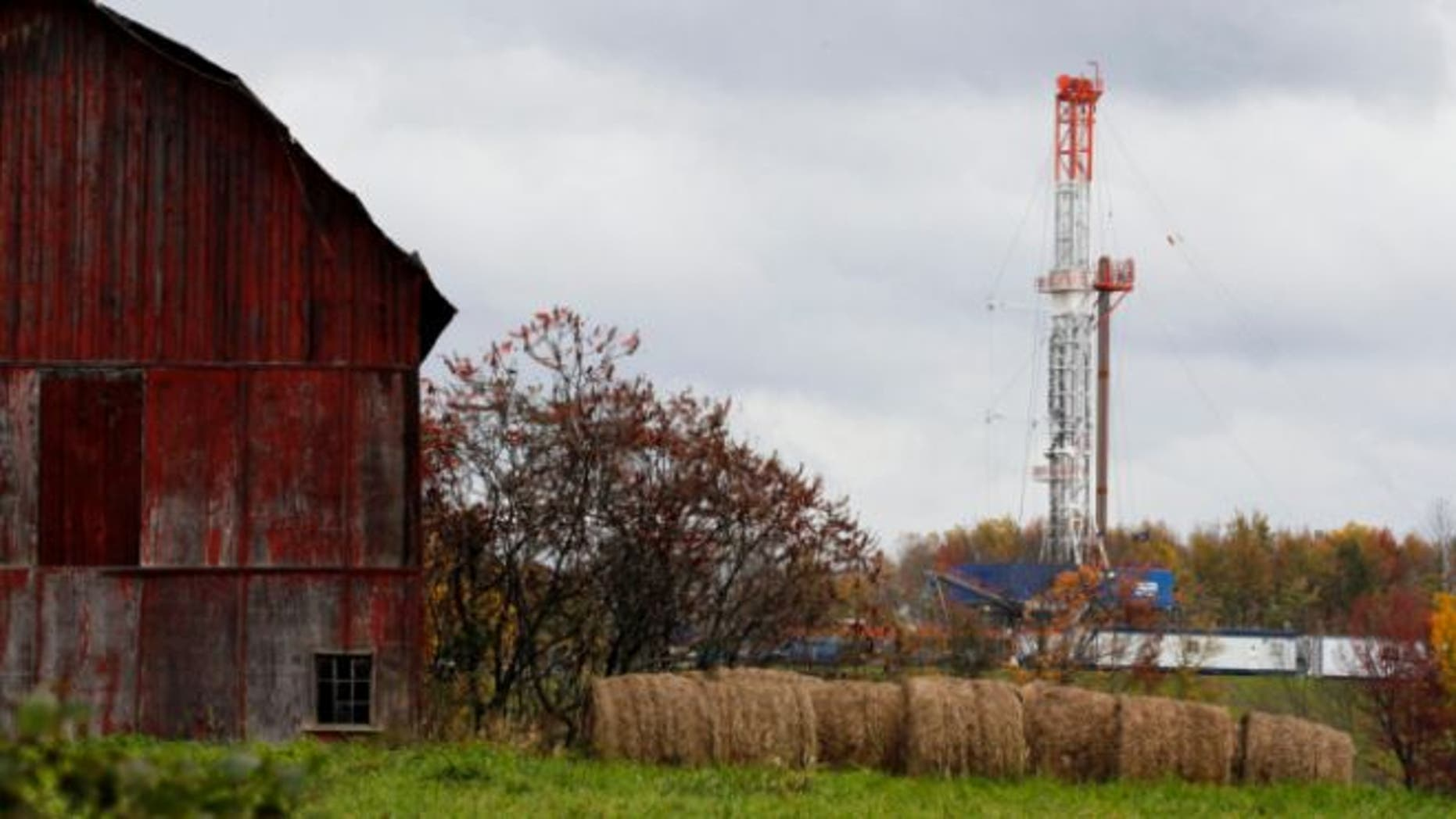 Oct. 14, 2011: A drilling rig is set up near a barn in Springville, Pa., to tap gas from the giant Marcellus Shale gas field.