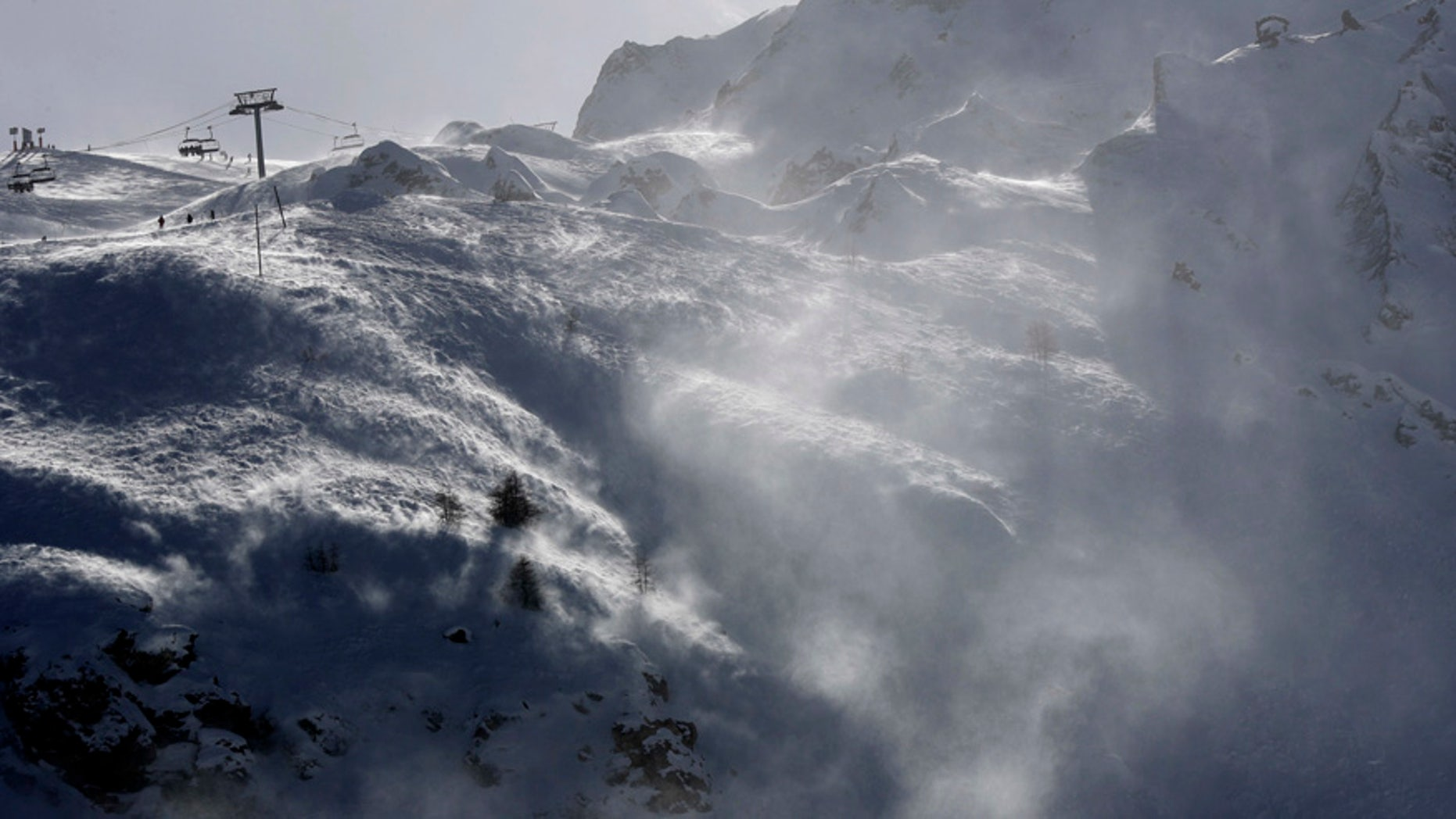 FILE - This Feb. 14, 2017 file photo shows the Lavachet Wall at the Tignes ski resort, French Alps. French officials say an avalanche has struck the Alpine ski resort of Tignes Tuesday March 7, 2017, and rescue services have launched a search. (AP Photo/Luca Bruno, File)