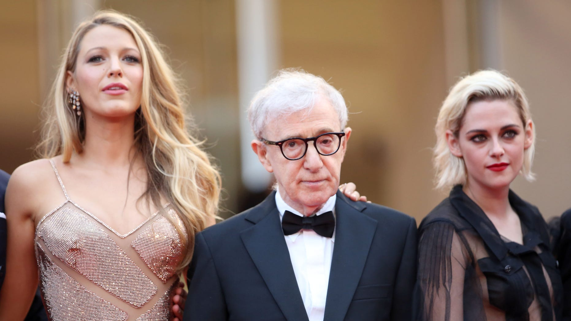 Actress Blake Lively, left, director Woody Allen and actress Kristen Stewart arrive on the red carpet for the screening of the film Cafe Society and the Opening Ceremony at the 69th international film festival, Cannes, southern France, Wednesday, May 11, 2016.