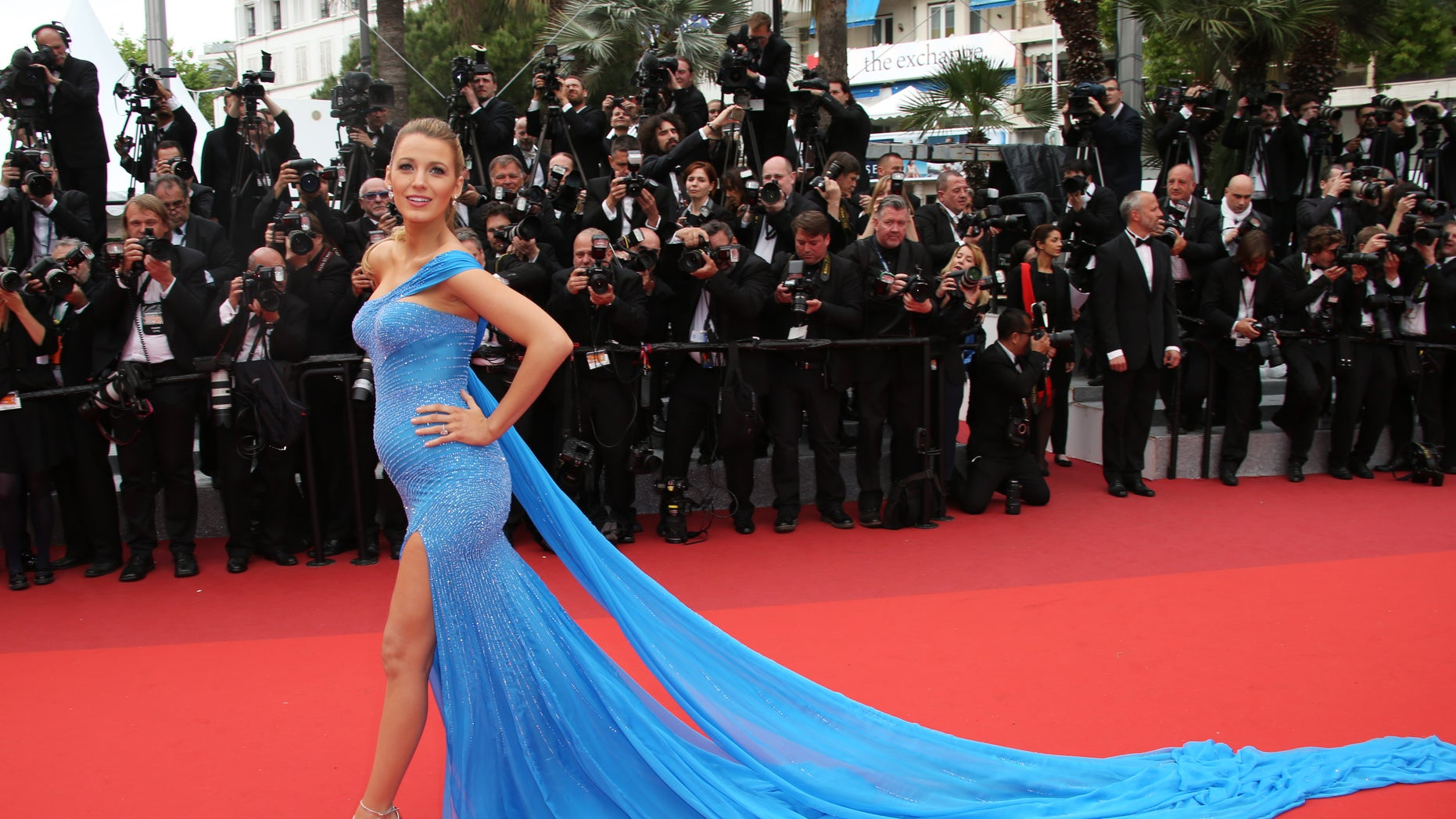 Actress Blake Lively poses for photographers upon arrival at the screening of the film The BFG at the 69th international film festival, Cannes, southern France, Saturday, May 14, 2016. (AP Photo/Joel Ryan)