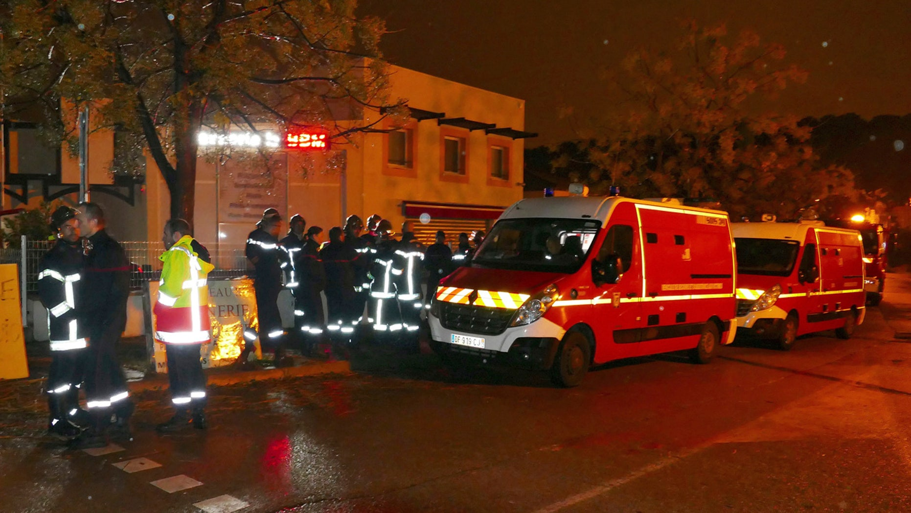 Firefighters and ambulances are seen in the village of Montferrier-sur-Lez, southern France, Friday, Nov. 25, 2016.