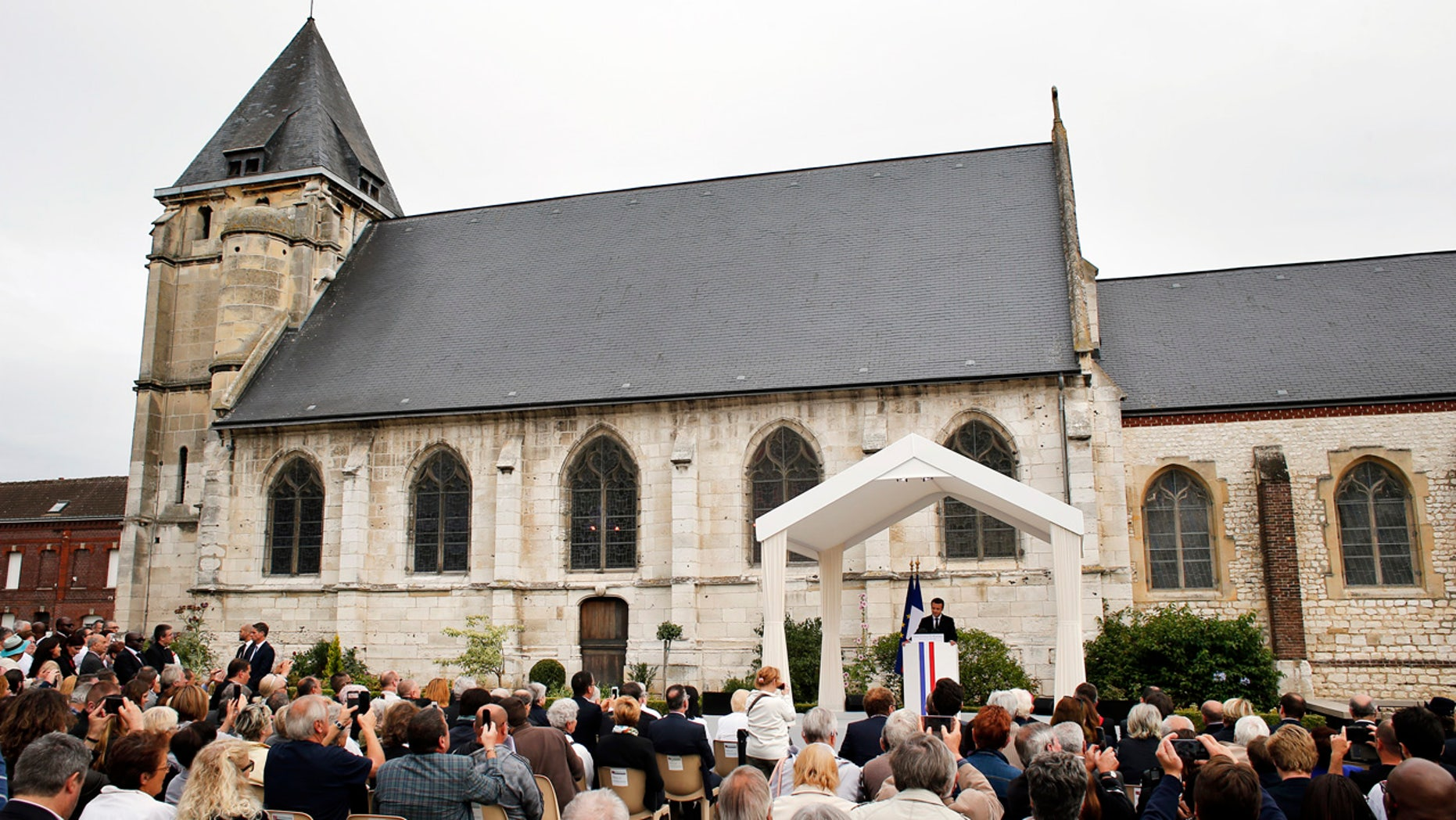 France's President Emmanuel Macron delivers a speech during a ceremony marking the first anniversary of the killing of Catholic priest Jacques Hamel by two jihadists at his church.